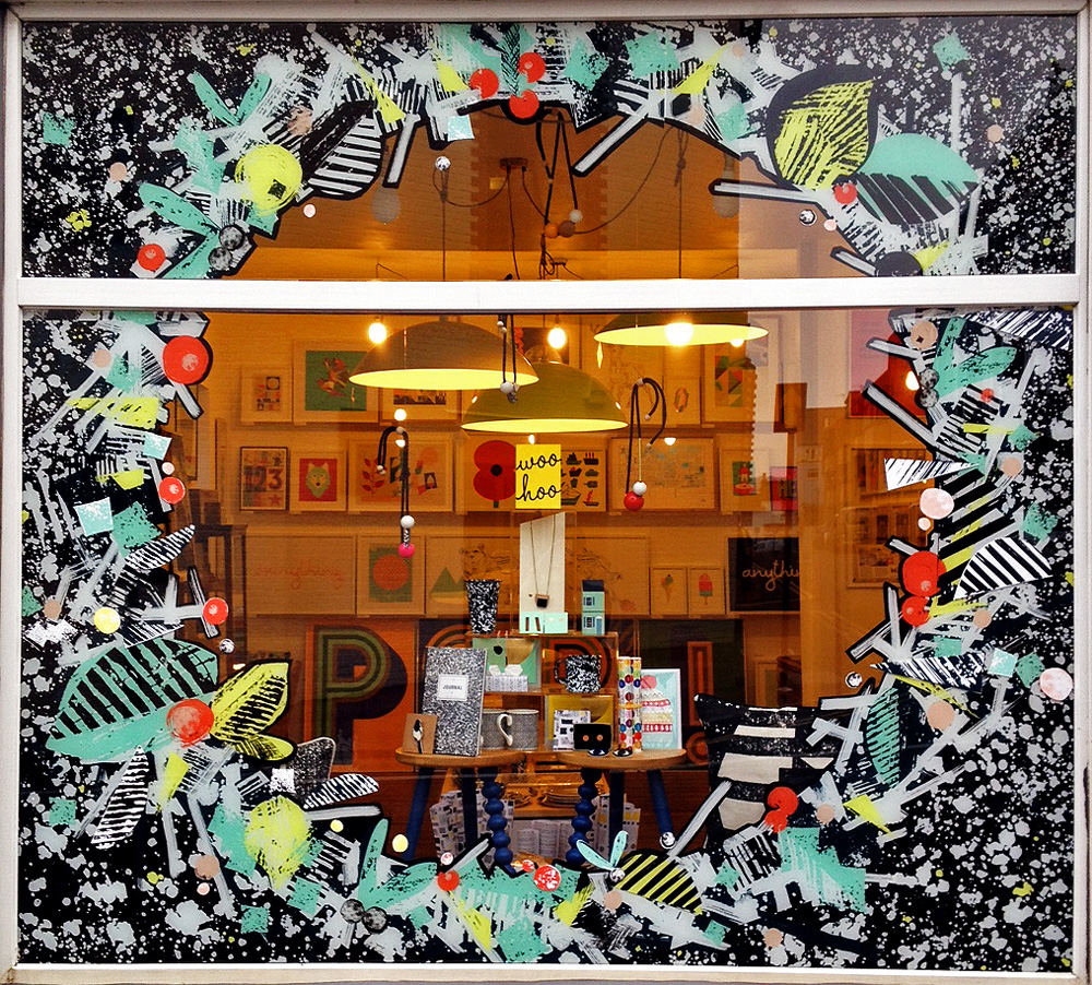 Christmas Window created for  Unlimited's  shop front; a festive display, reflecting the gallery's graphic black and white Christmas theme and using pops of colour to reveal the store's colourful interior. Nov 2014