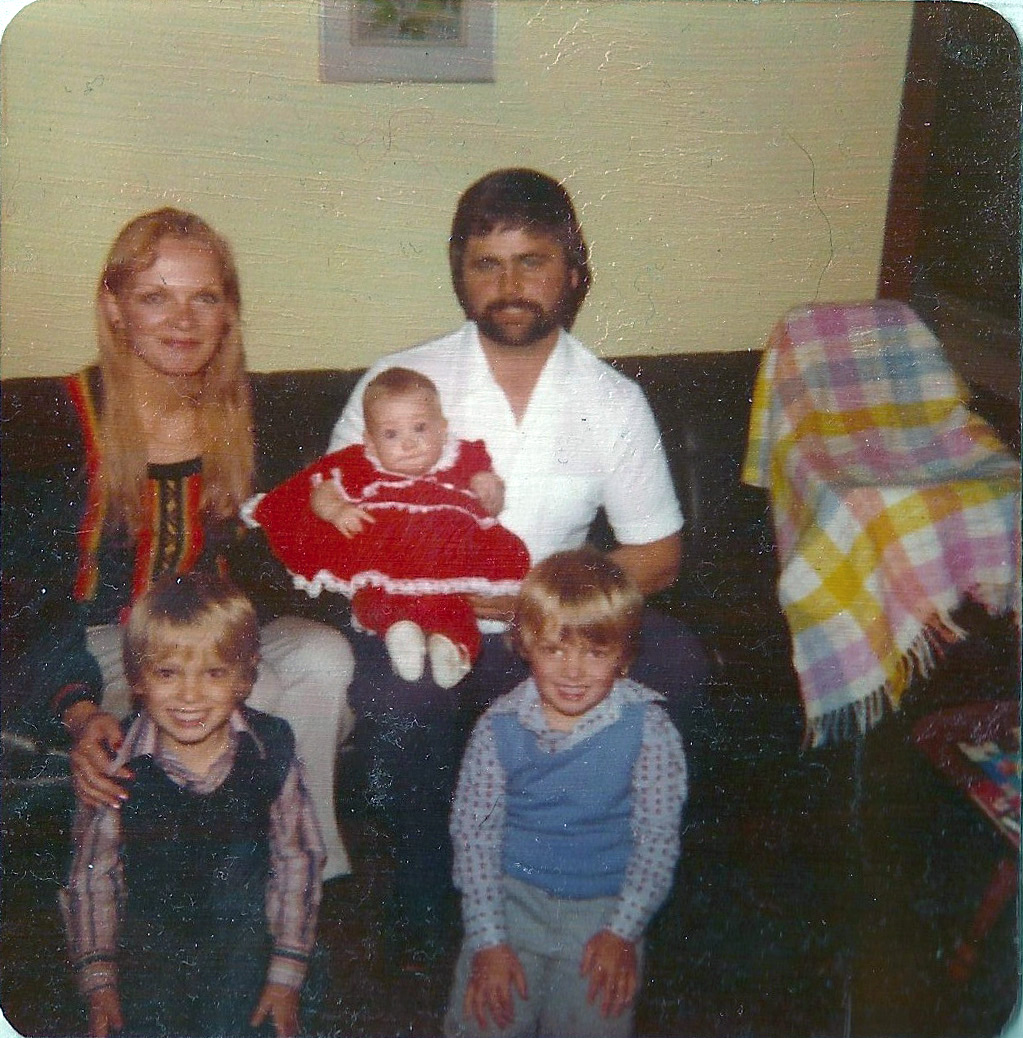 My family, circa 1978, sitting on our beloved black vinyl couch.