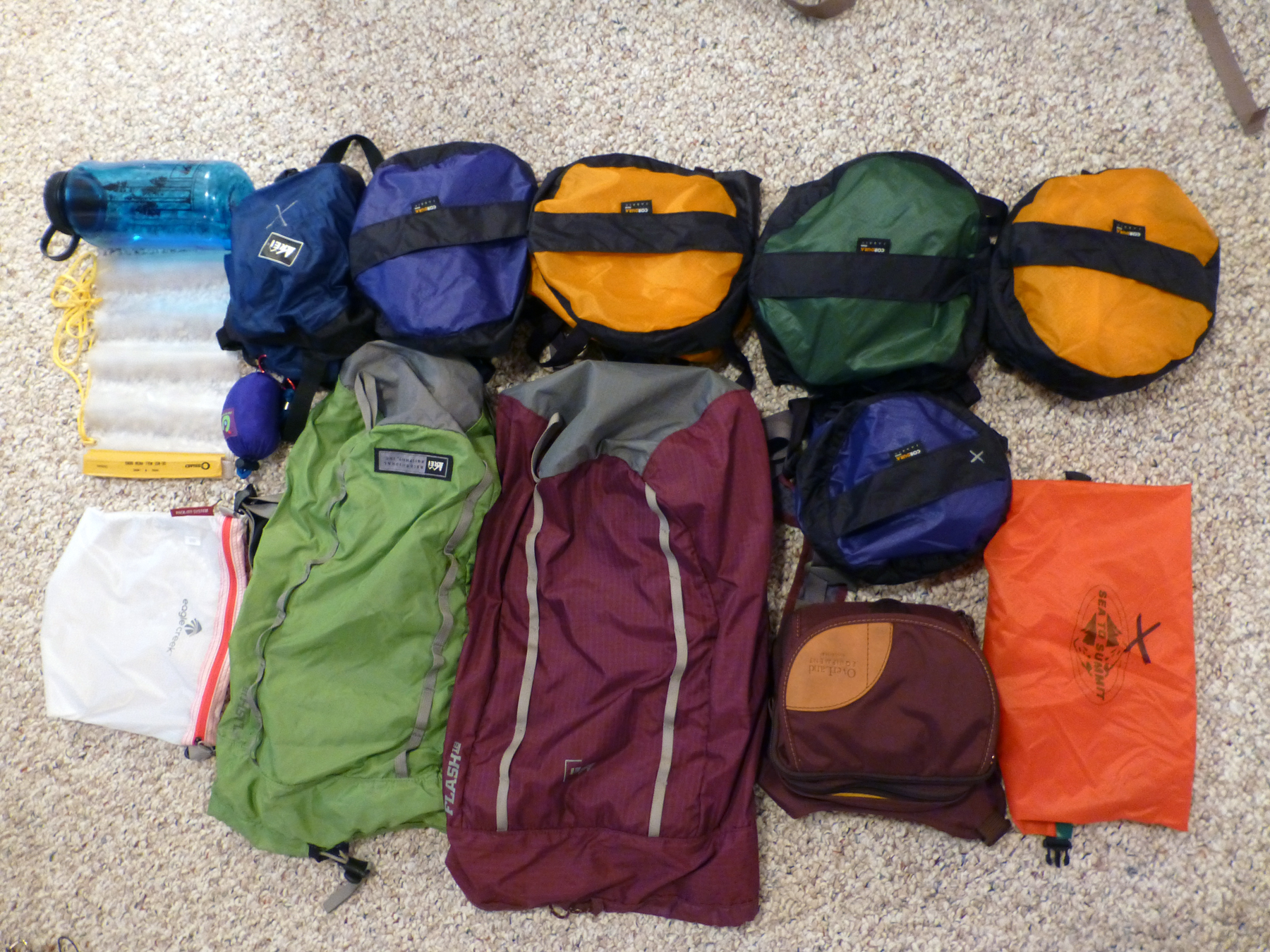 Our daypacks and compression sacks (among other things). We each have three compression sacks: 1 for clothes, 1 for underwear / socks / misc., and 1 for dirty laundry.