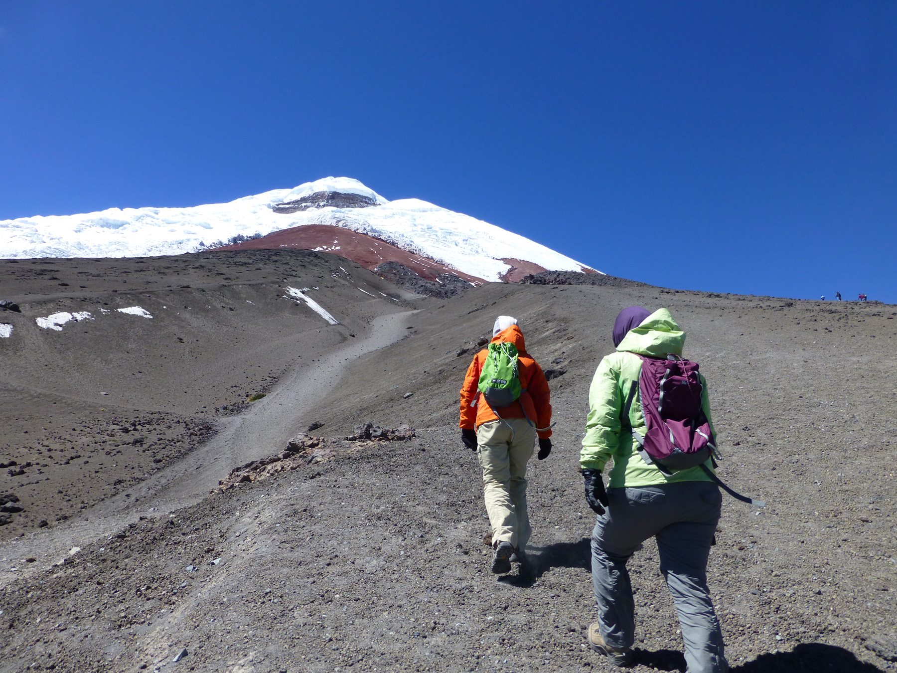 """Katie and myself hiking up Mount Cotopaxi. """"Concentration, concentration. Slow, slow."""" Words to live by."""