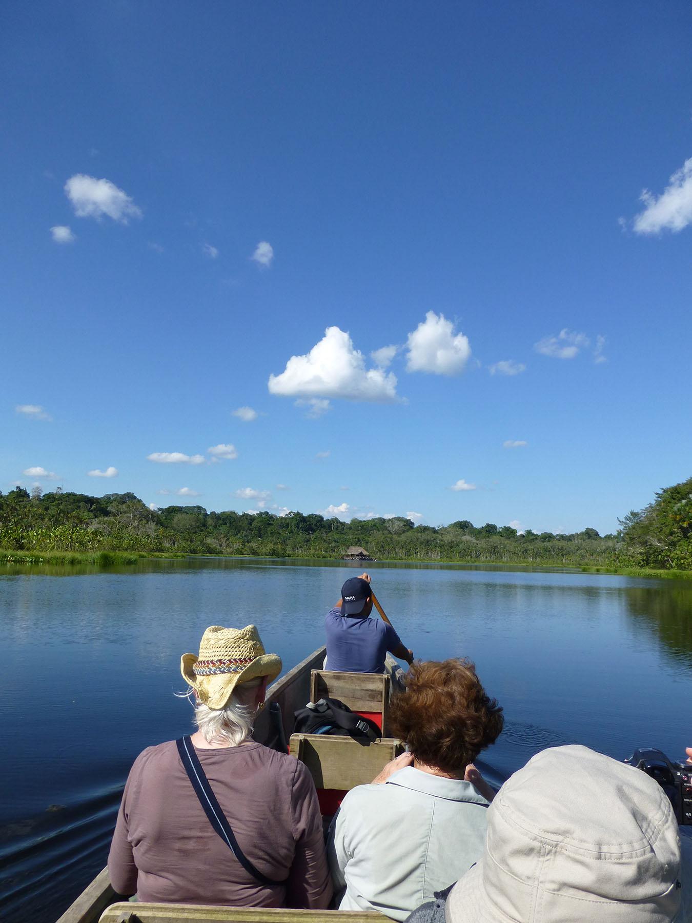 Taking a canoe across Lake Pilcicocha to Sacha Lodge.