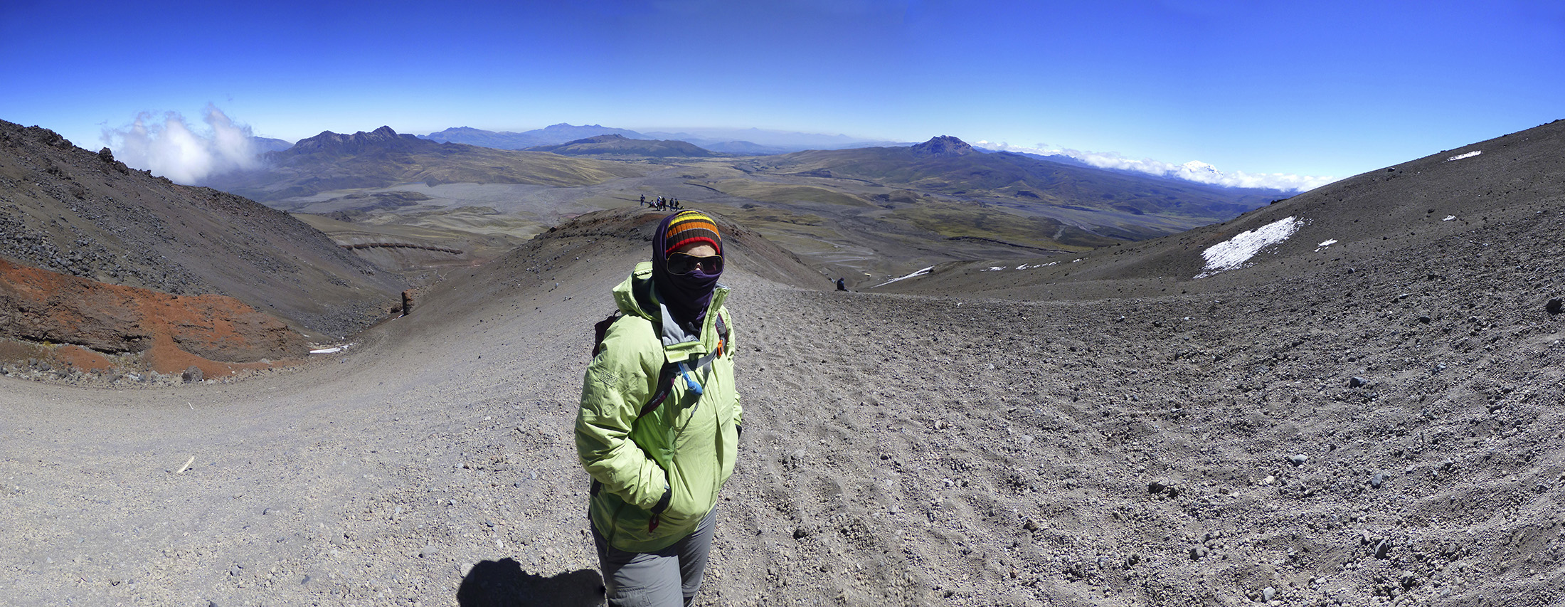 Katie standing center stage on a perfect Cotopaxi climbing day. Check out that view!