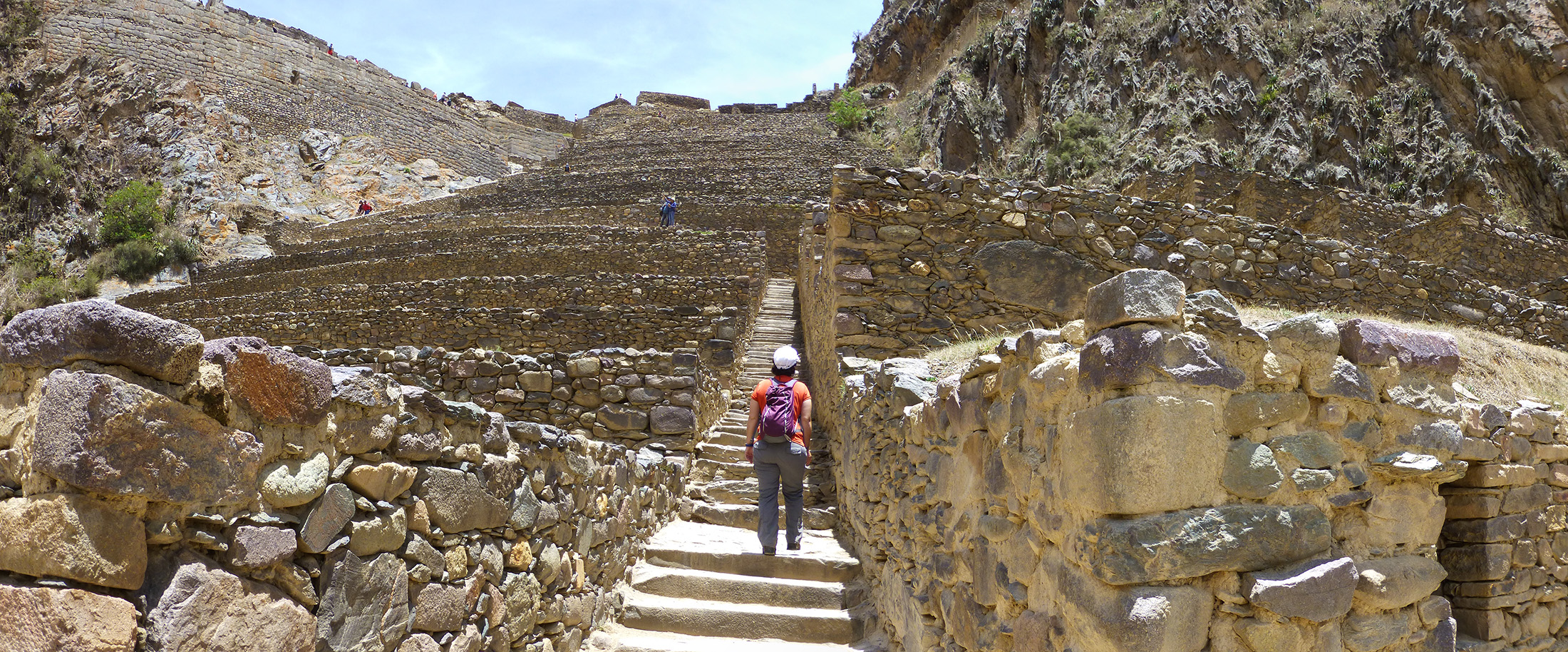 Katie climbing the mighty steps of Ollantaytambo ruins.