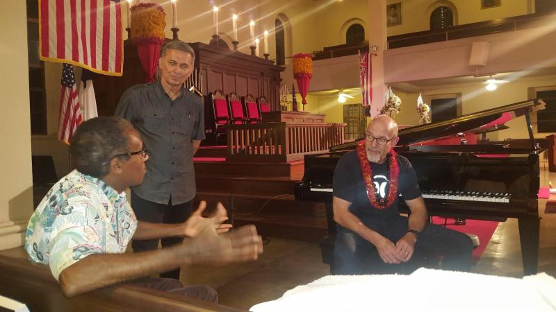 Being introduced to a new friend by my buddy, Pastor Rojo (standing) in Honolulu