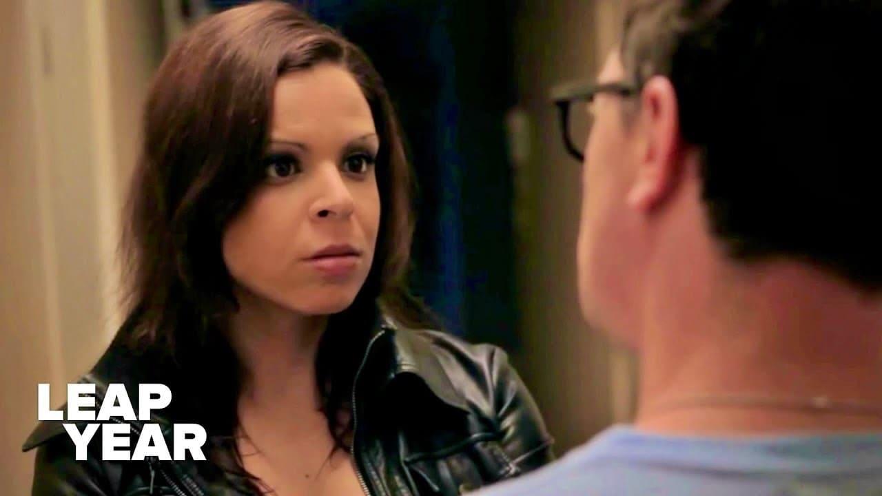 Olivia (Daniela DiIorio) catches her boyfriend Sam (Joshua Malina) in a lie.