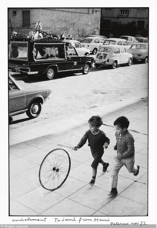 """""""Palerme"""" (boy with wheel) by Henri Cartier-Bresson, 1971/1972. Trying to respect copyrights and all,  I found this digital copy here on the internet."""
