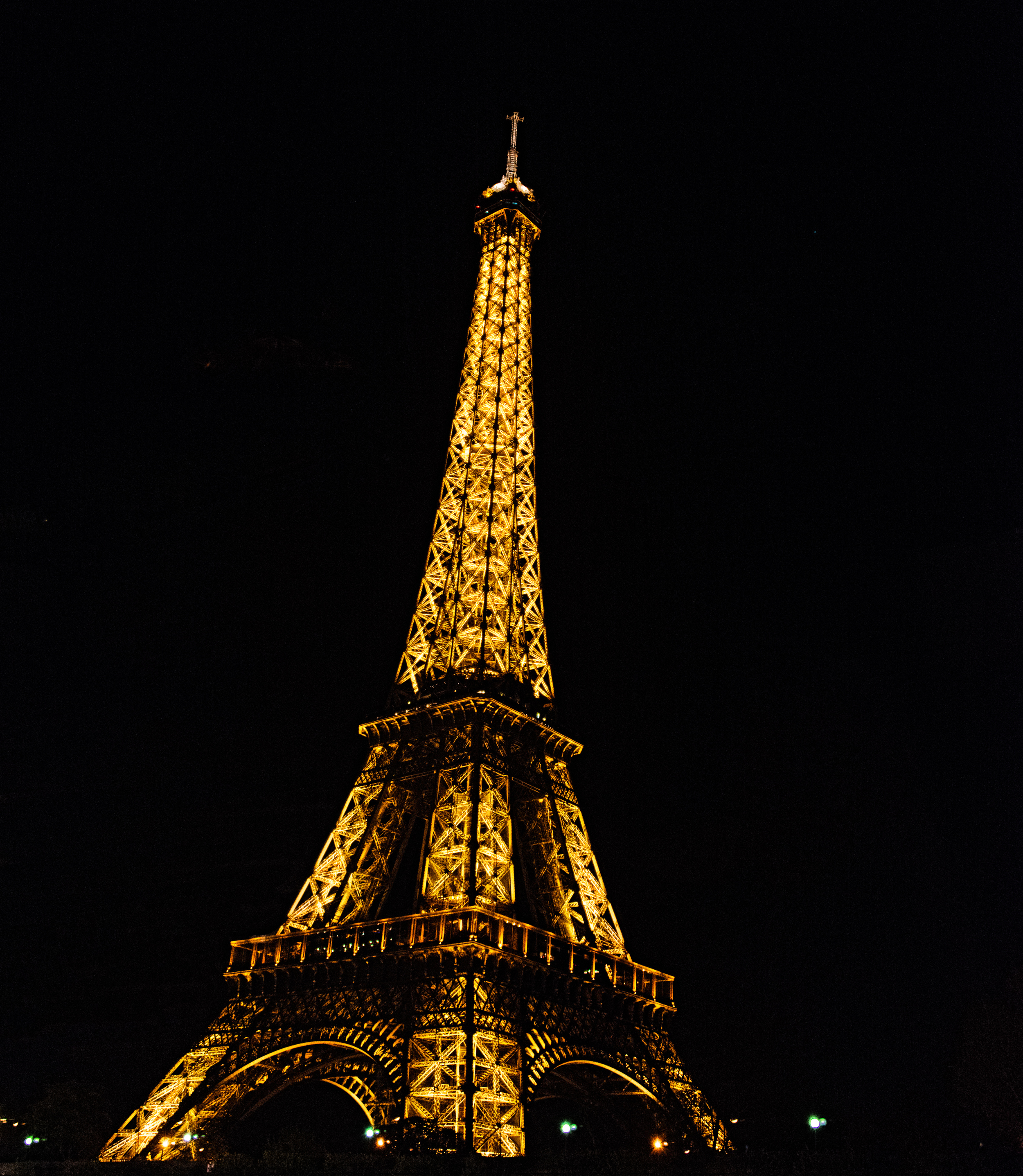 The Eiffle Tower at night from the Seine River