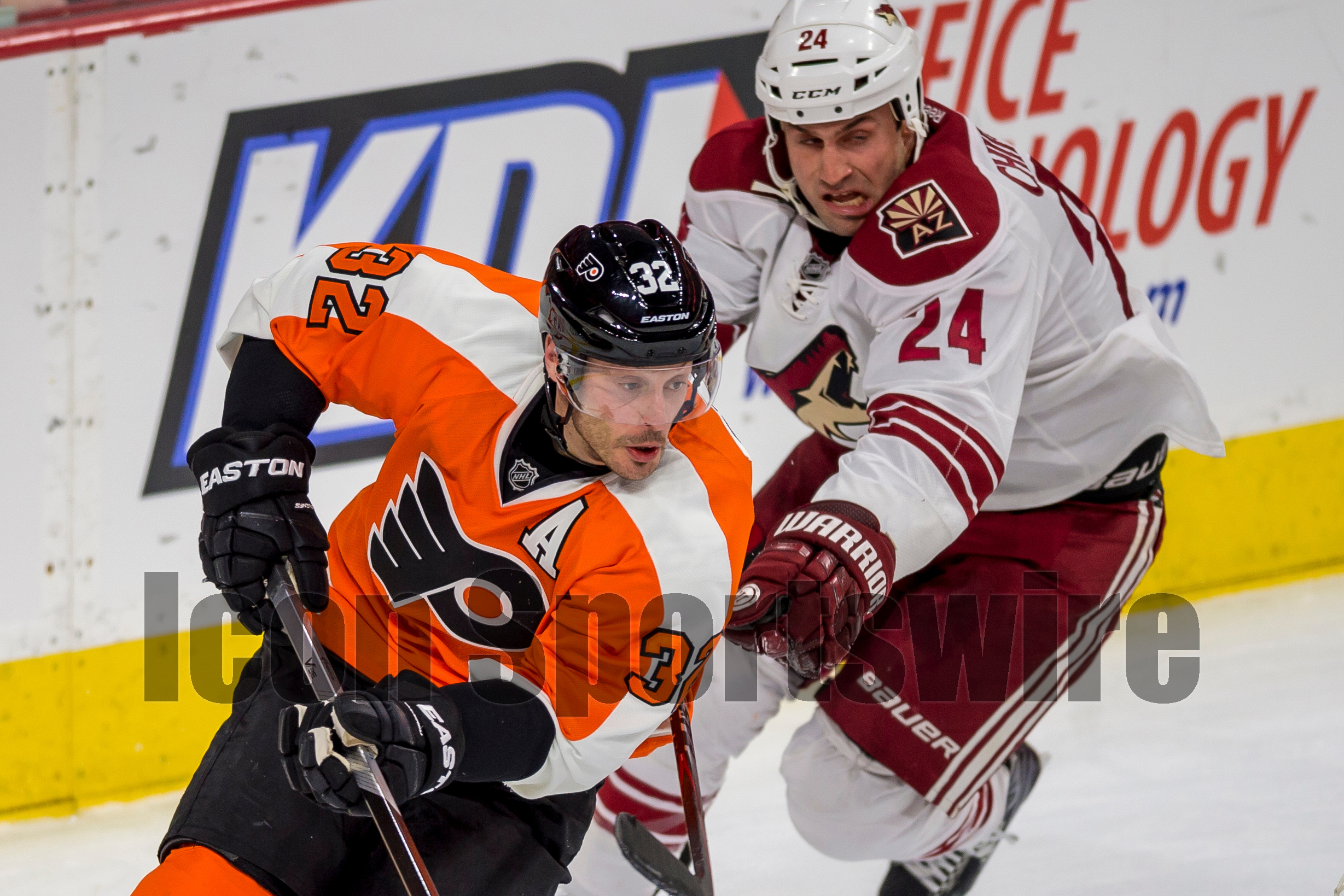 27 Jan 2015: Arizona Coyotes center Kyle Chipchura (24) chases Philadelphia Flyers defenseman Mark Streit (32) around the back of the net during the NHL game between the Arizona Coyotes and the Philadelphia Flyers played at the Wells Fargo Center in Philadelphia, PA
