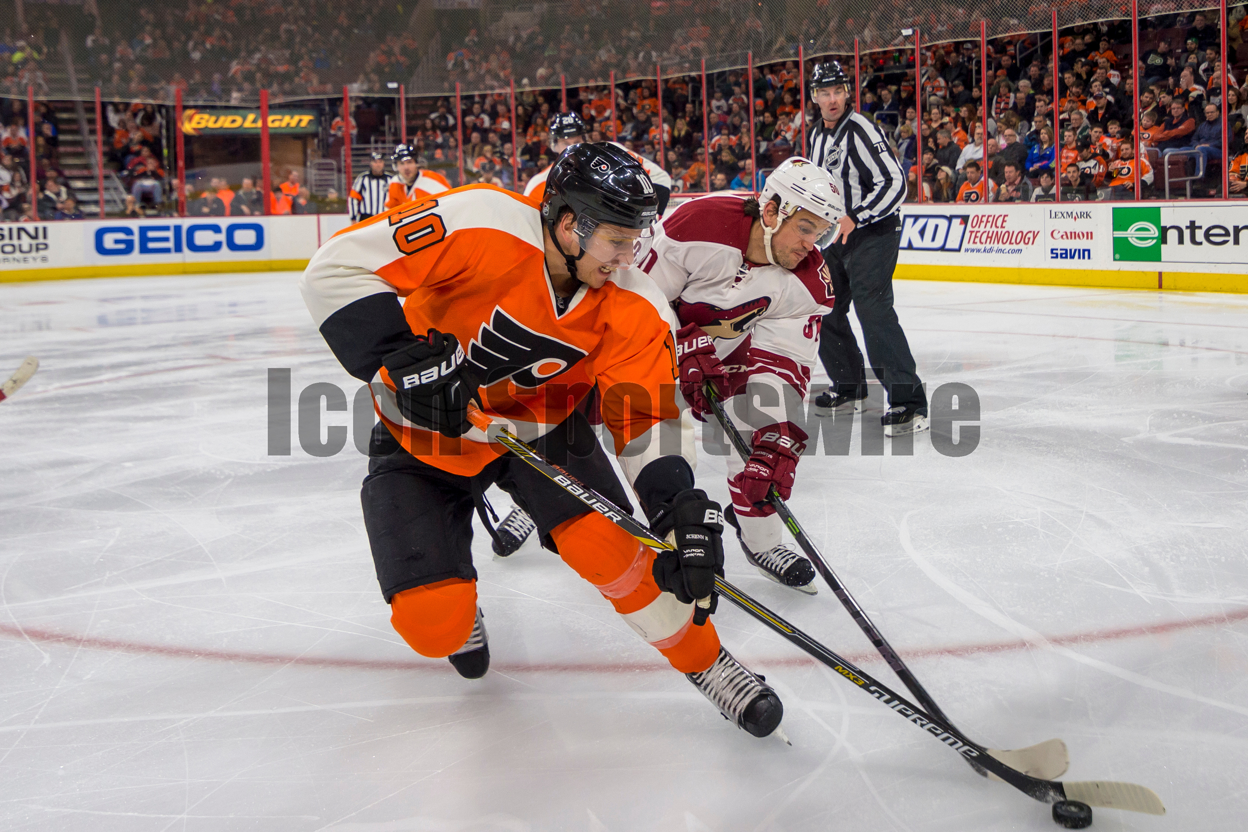 27 Jan 2015: Philadelphia Flyers center Brayden Schenn (10) tries to keep the puck away from his defender during the NHL game between the Arizona Coyotes and the Philadelphia Flyers played at the Wells Fargo Center in Philadelphia, PA