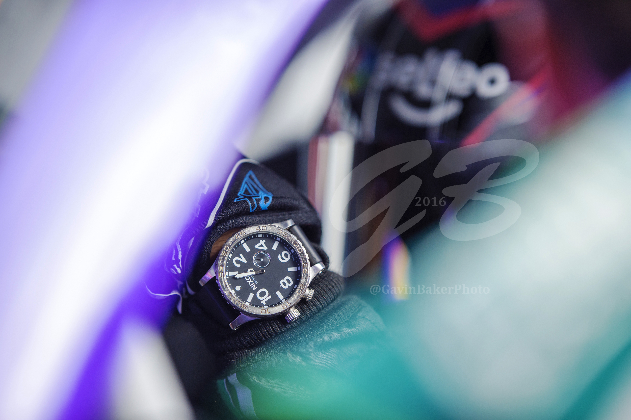 Darrell Wallace Jr shows off his Nixon watch as he backs the #6 Selfeo Ford out of the garage