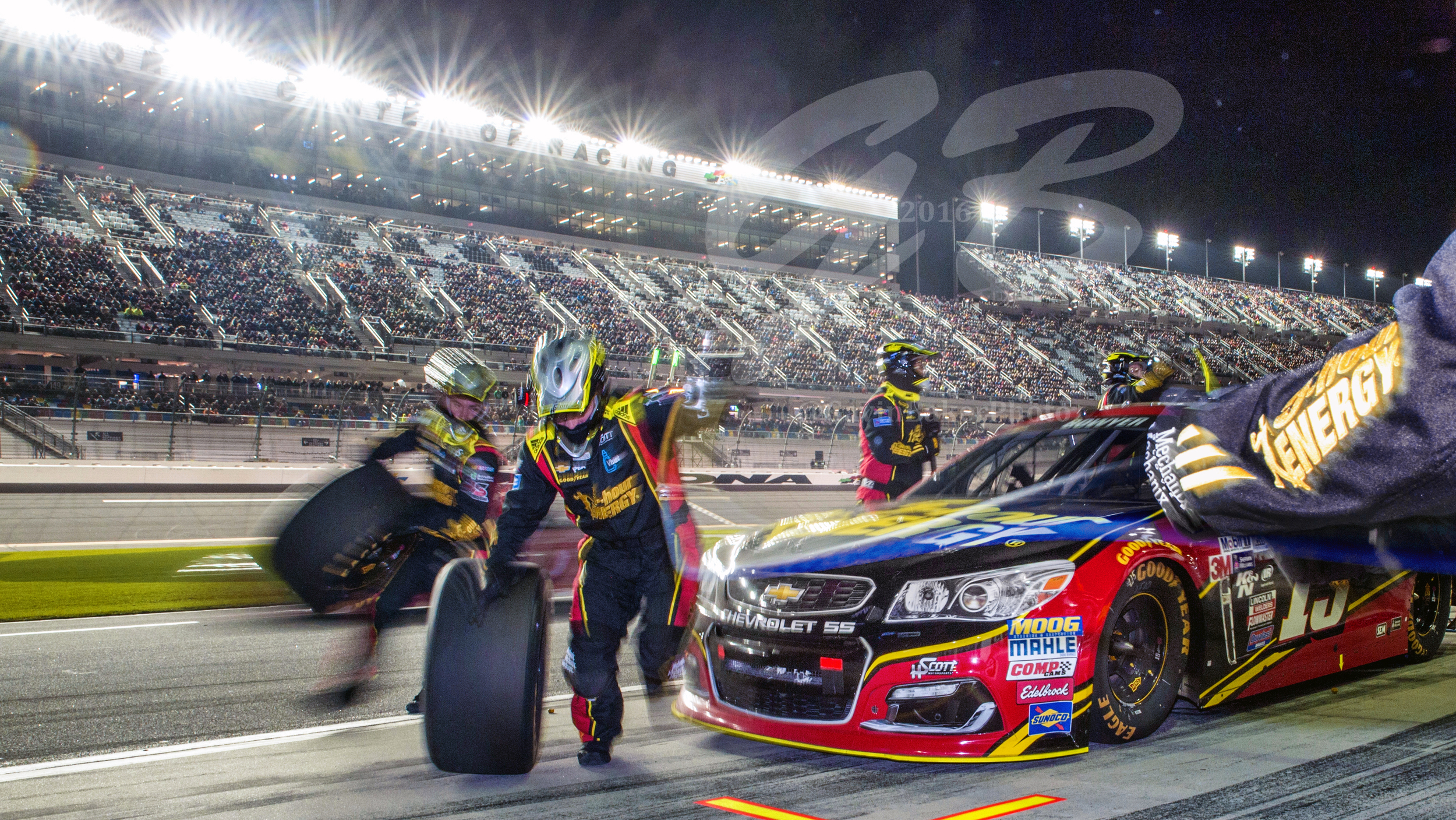 The 5-Hour Energy Chevy of Clint Bowyer gets its tires changed during a pit stop during the Can Am Race