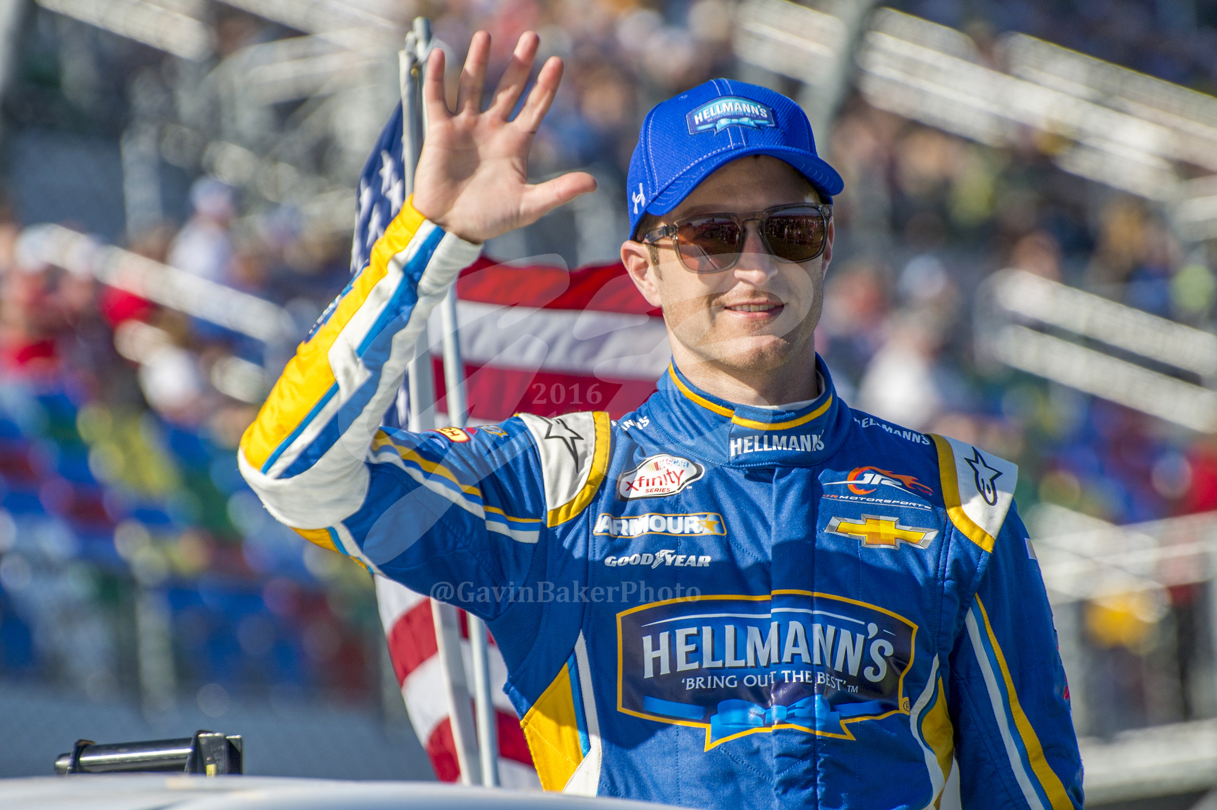 Kasey Kahne, driver of the #5 Hellmann's Chevy, waves to the crowd as he is taken to his racecar for the start of the Daytona 500