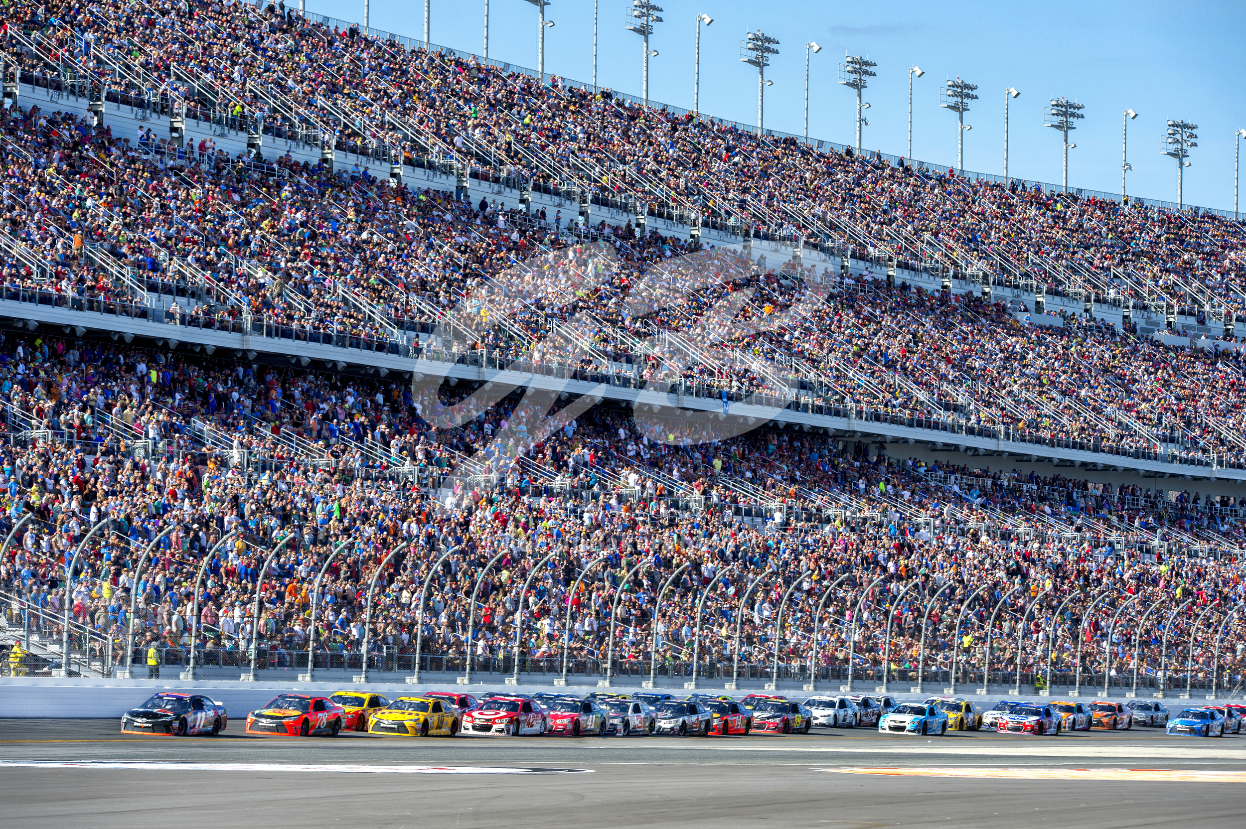 Denny Hamlin leads the field in the #11 FedEx Express Toyota as he enters turn one during the Daytona 500