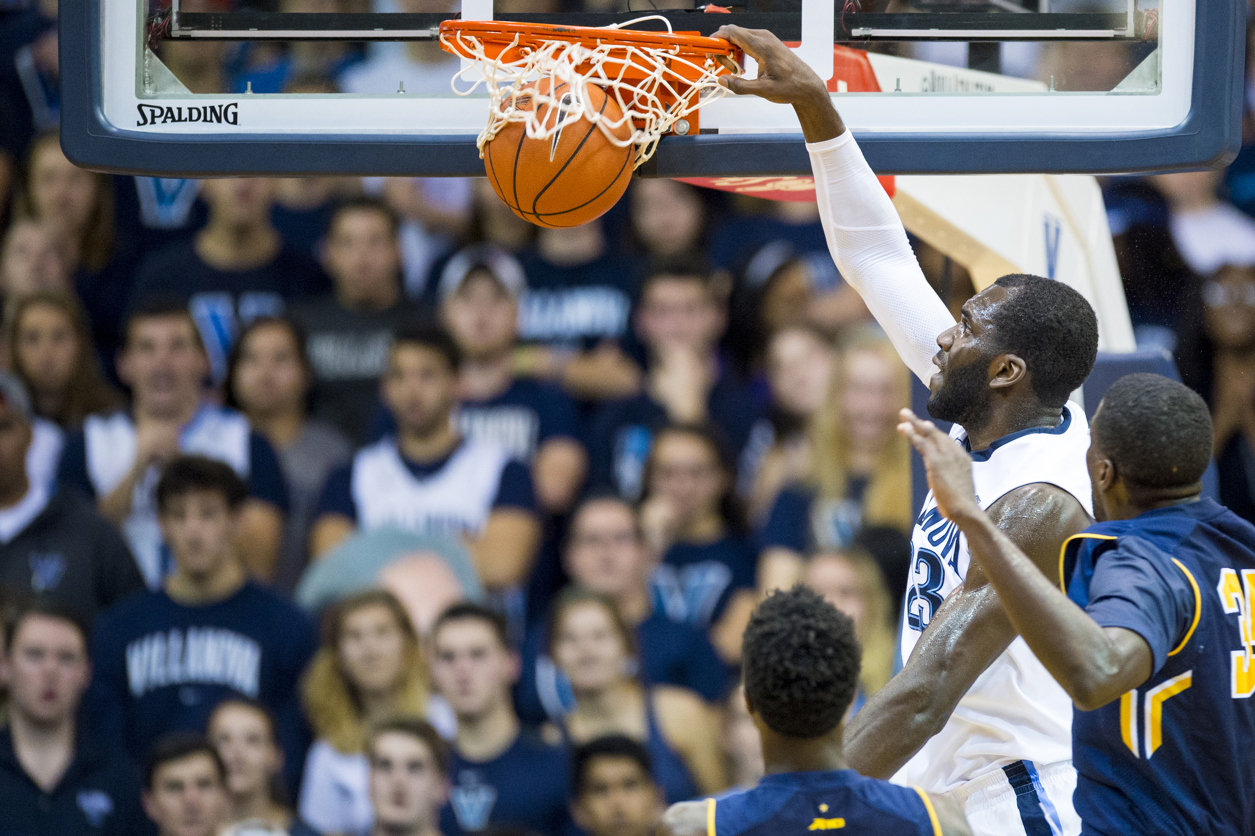 13 December 2015: Villanova Wildcats forward Daniel Ochefu (23) slam dunks the ball during the NCAA basketball game between the La Salle Explorers and the Villanova Wildcats played at the Pavilion in Villanova, PA. (Photo by Gavin Baker/Icon Sportswire)