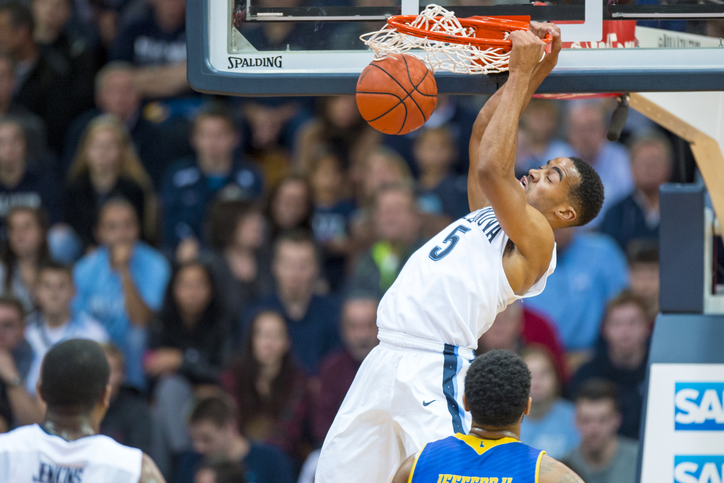 22 December 2015: Villanova Wildcats guard Phil Booth (5) hangs on the rim after his dunk during the NCAA basketball game between the Delaware Blue Hens and the Villanova Wildcats played at the Pavillion in Villanova, PA. (Photo by Gavin Baker/Icon Sportswire)