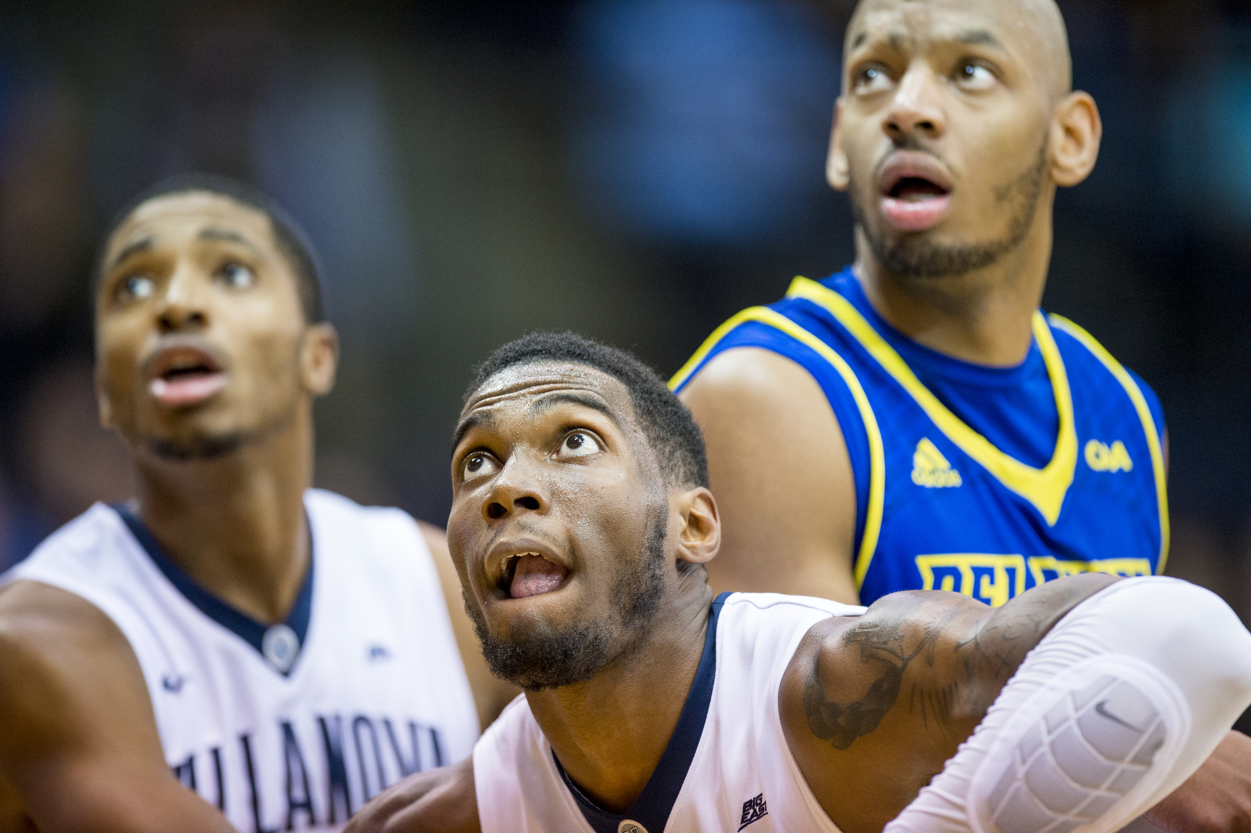 22 December 2015: Villanova Wildcats forward Darryl Reynolds (45) and Villanova Wildcats guard Mikal Bridges (25) and Delaware Fightin Blue Hens forward Barnett Harris (2) looks for the rebound to fall during the NCAA basketball game between the Delaware Blue Hens and the Villanova Wildcats played at the Pavillion in Villanova, PA. (Photo by Gavin Baker/Icon Sportswire)