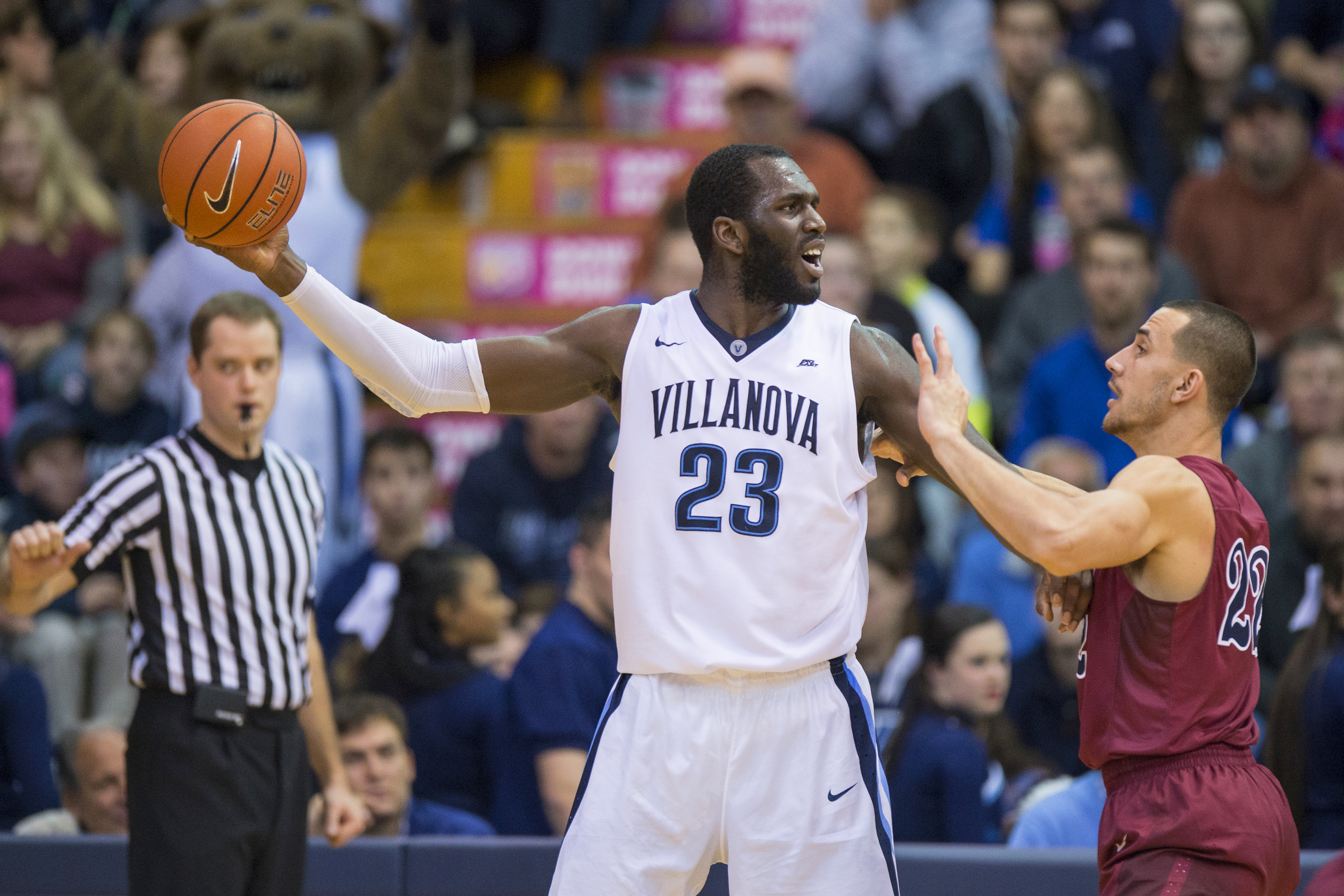 28 December 2015: Villanova Wildcats forward Daniel Ochefu (23) holds the ball away from Pennsylvania Quakers forward Mike Auger (22) during the NCAA men's basketball game between the Penn Quakers and the Villanova Wildcats played at Pavillion in Villanova, PA. (Photo by Gavin Baker/Icon Sportswire)