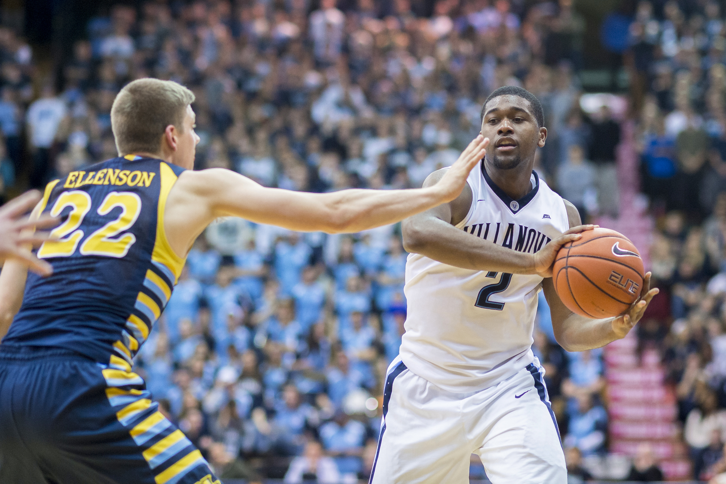 13 January 2016: Villanova Wildcats forward Kris Jenkins (2) passes around Marquette Golden Eagles guard Wally Ellenson (22) during the NCAA Men's basketball game between the Marquette Golden Eagles and the Villanova Wildcats played at the Pavilion in Villanova, PA. (Photo by Gavin Baker/Icon Sportswire)