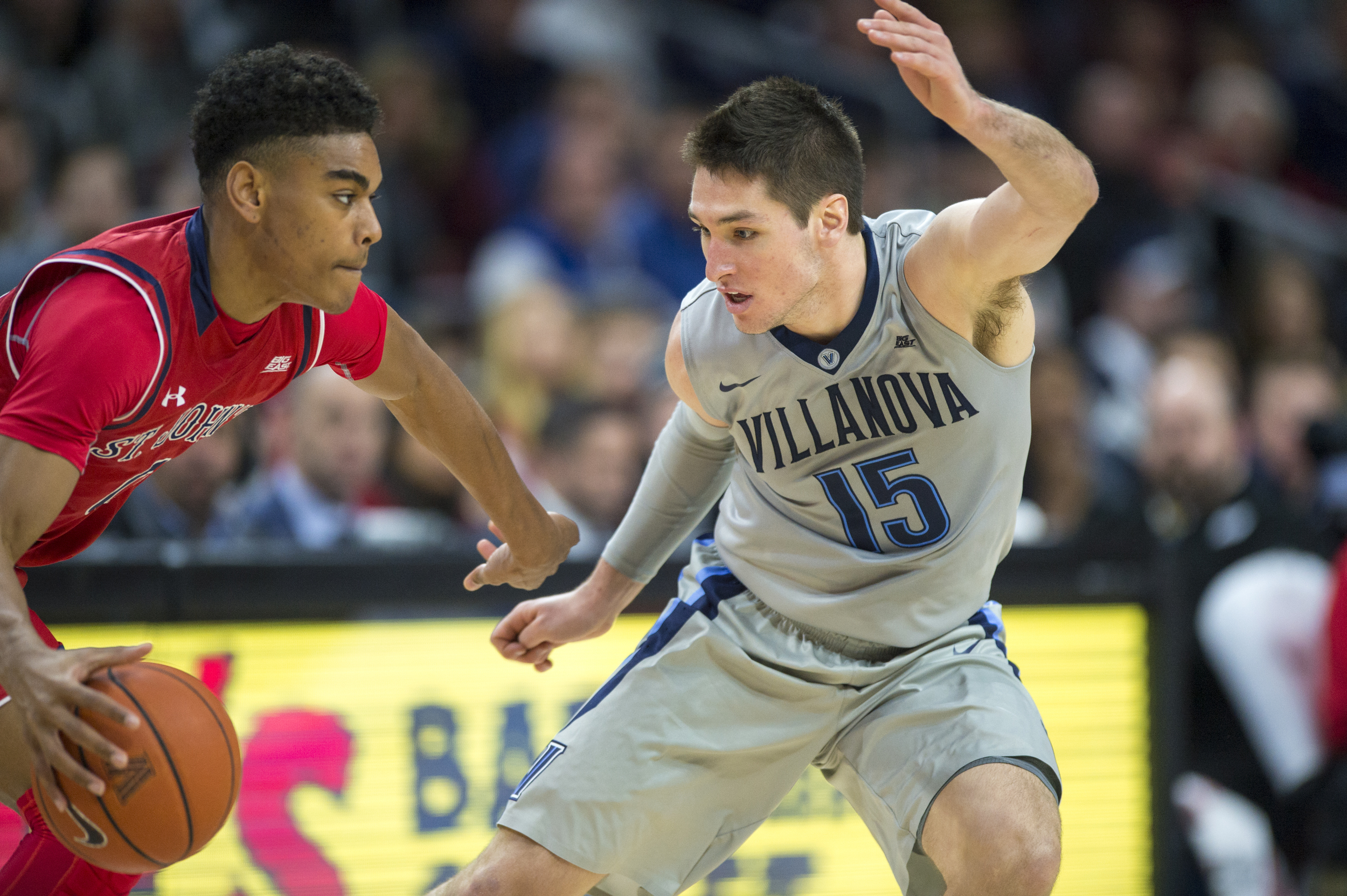 13 February 2016: Villanova Wildcats guard Ryan Arcidiacono (15) puts the pressure on St. John's Red Storm guard Malik Ellison (0) during the NCAA basketball game between the St. John's Red Storm and the Villanova Wildcats played at the Wells Fargo Center in Philadelphia, PA. (Photo by Gavin Baker/Icon Sportswire)