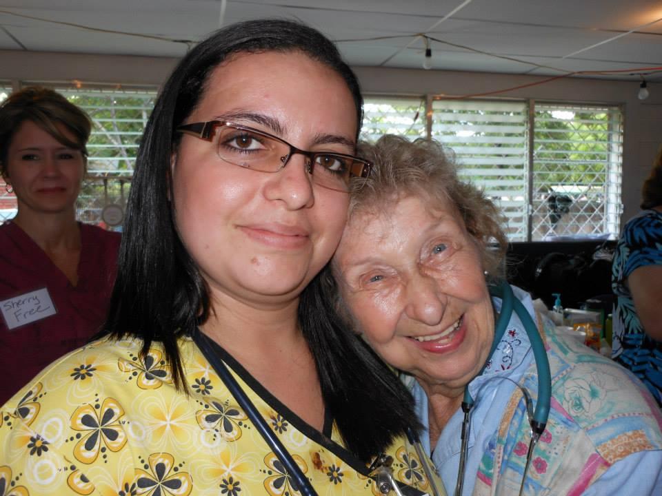 Dr. Karla Escalante hugging a patient.