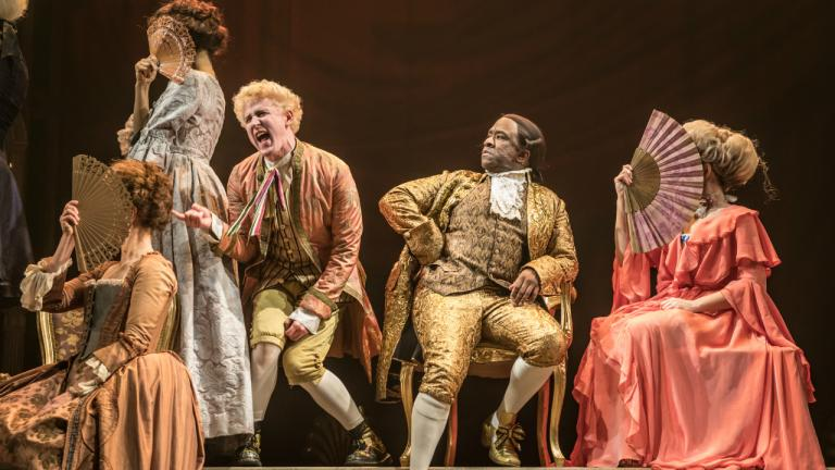 adam_gillen_as_wolfgang_mozart_and_lucian_msamati_as_antonio_salieri_in_amadeus_at_the_national_theatre_c_marc_brenner.jpg