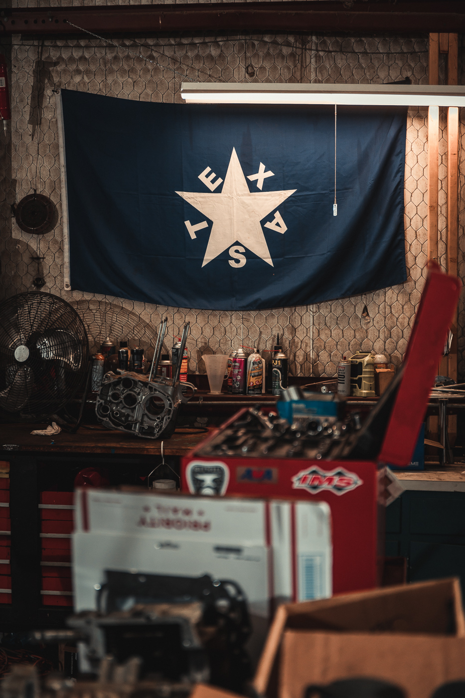 Texas flag on the wall of a motorcycle automotive shop