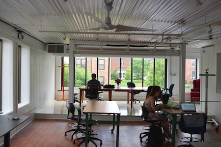 Our new Chapel Hill office right on Franklin St. -- comes complete with a bar and ping pong table!
