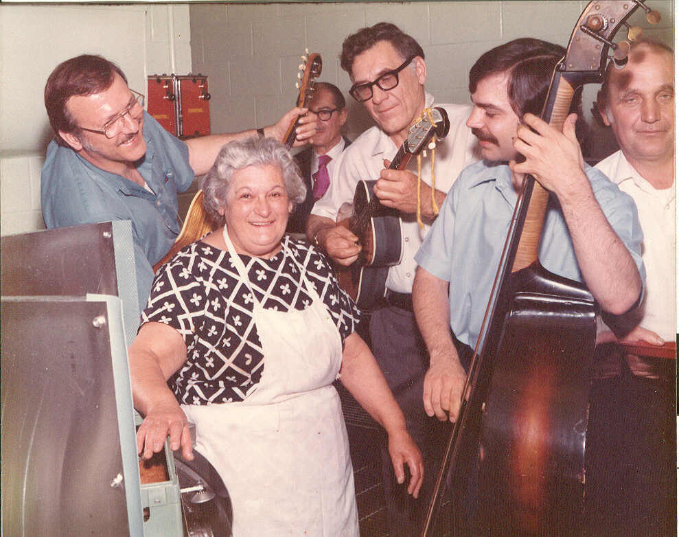 mary vernino getting serenaded while working in the dishroom.jpg