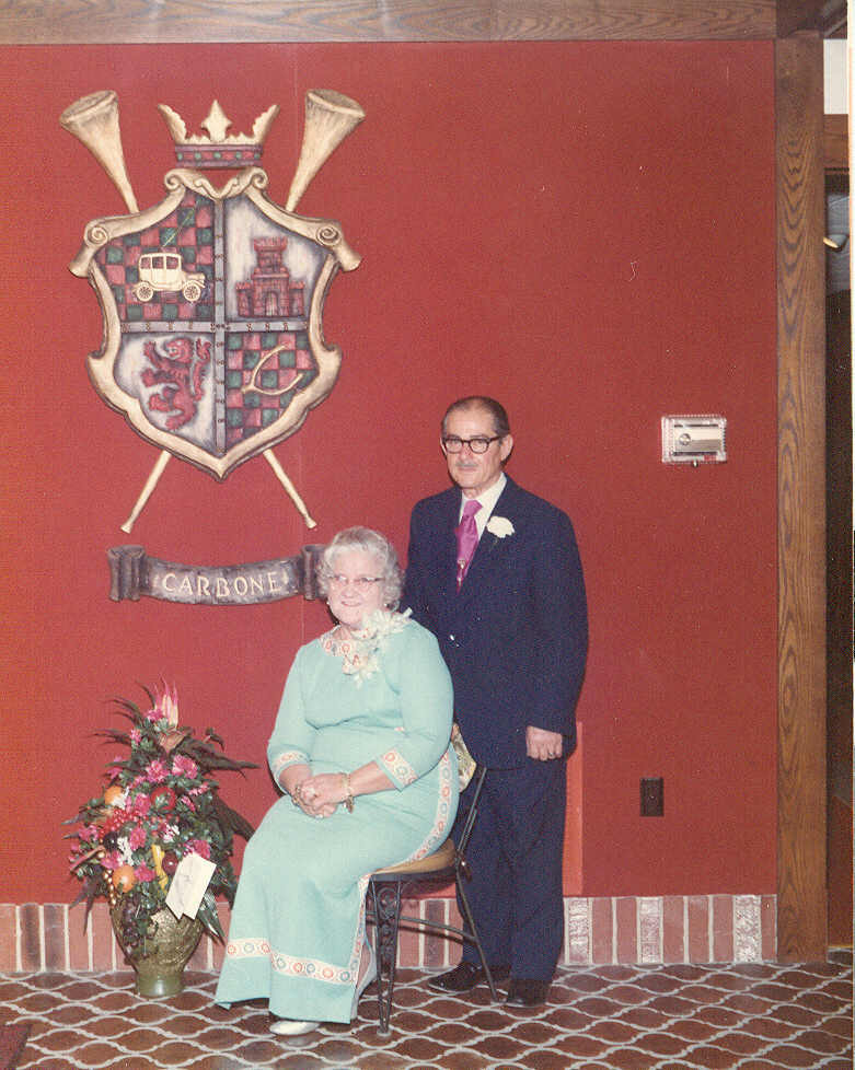 nat and mary carbone with the carbone's restaurant crest at .jpg