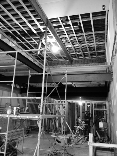 From the bottom of the future stair to the second level. Cedar joist being installed above and general framing below.