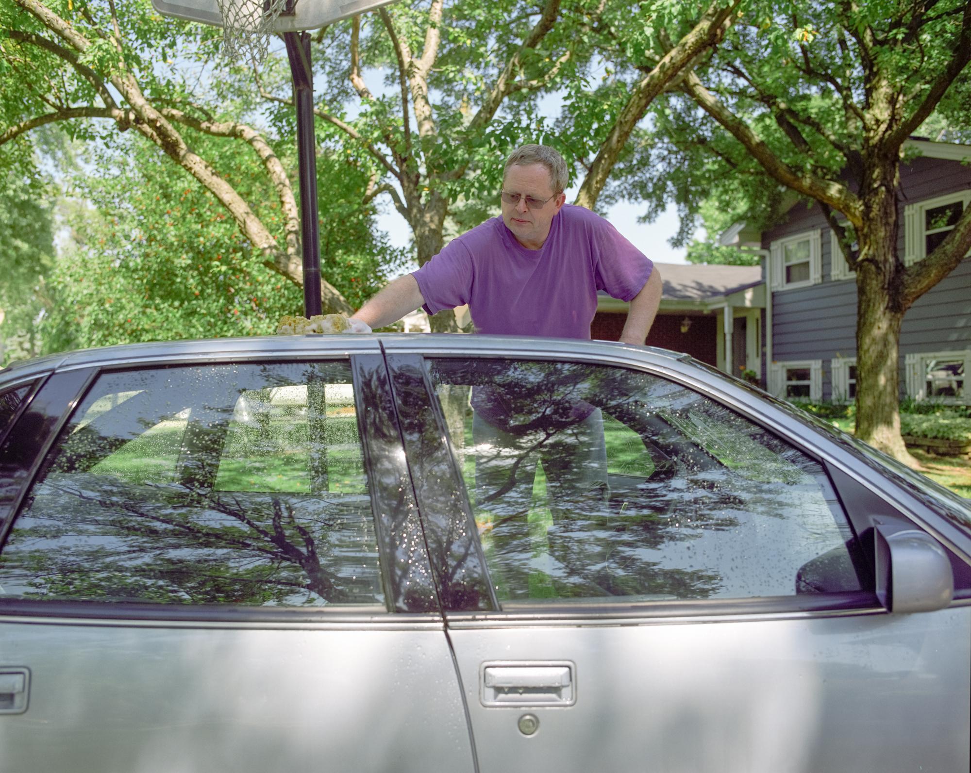 Neil. Washing the Car.