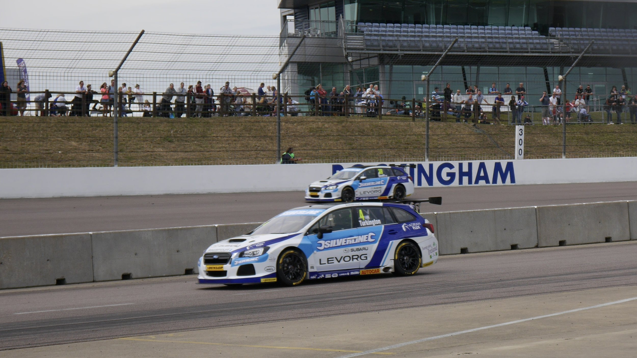 Colin Turkington exits the pits with a model of Warren Scott's Levorg on his roof