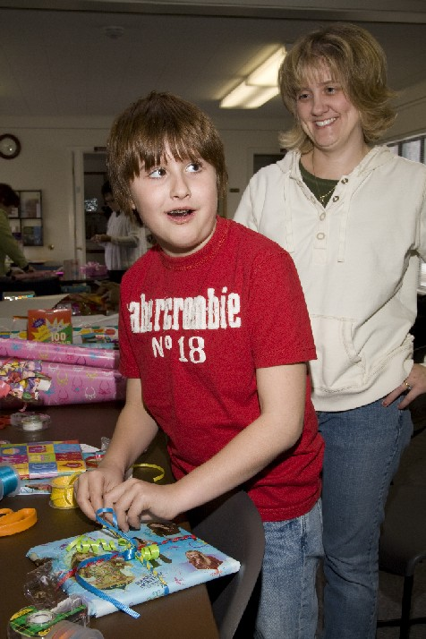 Church members of all ages enjoy wrapping gifts for children served by the Children's Birthday Project.