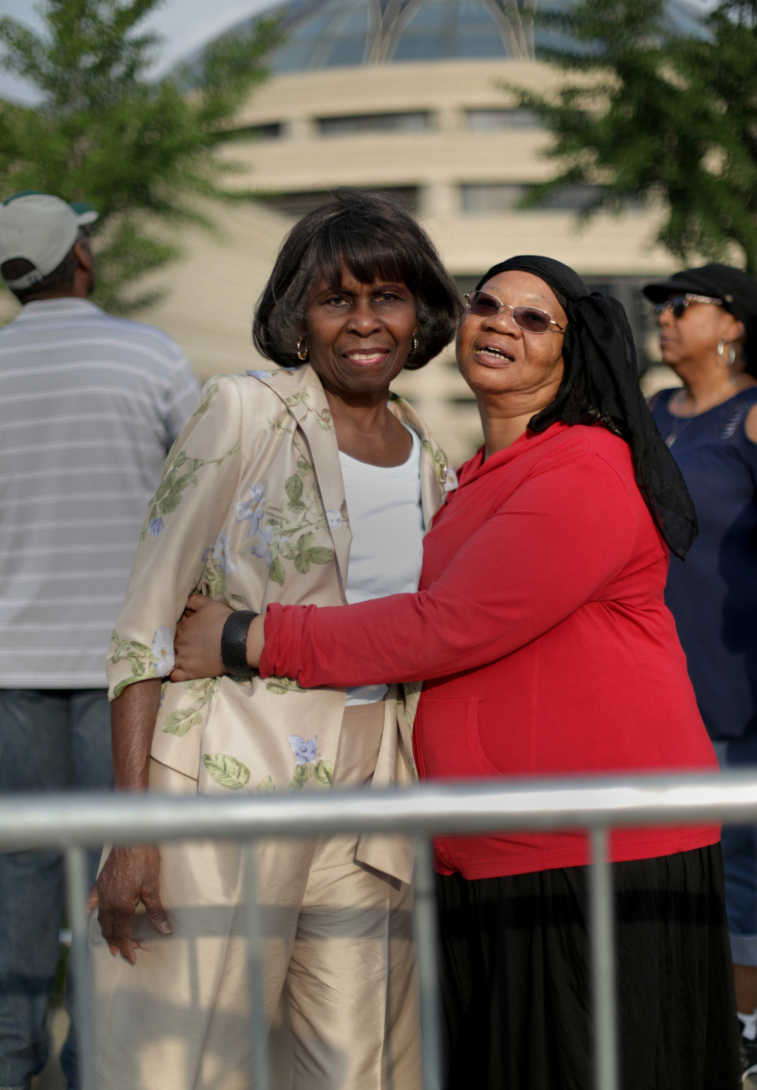 Mary McDonald, 75 of Southfield, left and Denise Washington of Highland Park. The two women just met while standing in line.