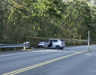 crashed car broken telephone pole