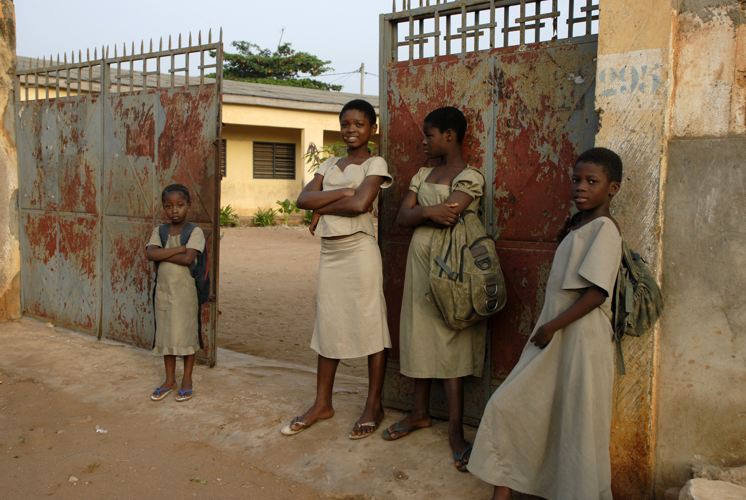 Students wait outside the Tokoin-Gbonvie elementary school in Lomé, Togo.