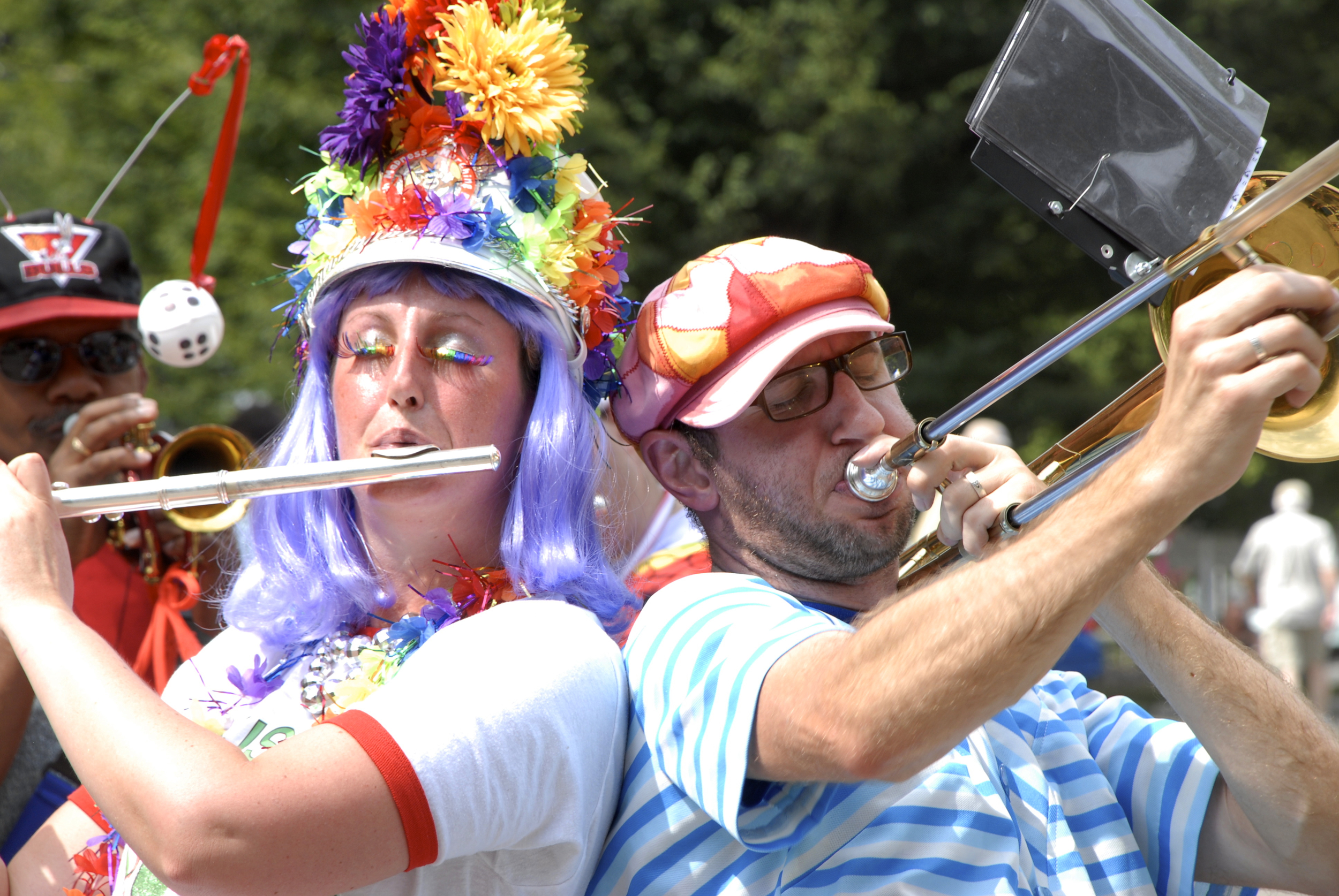 Members of the March Madness Marching Band perform at the 2011 Louisville Art Car Parade.