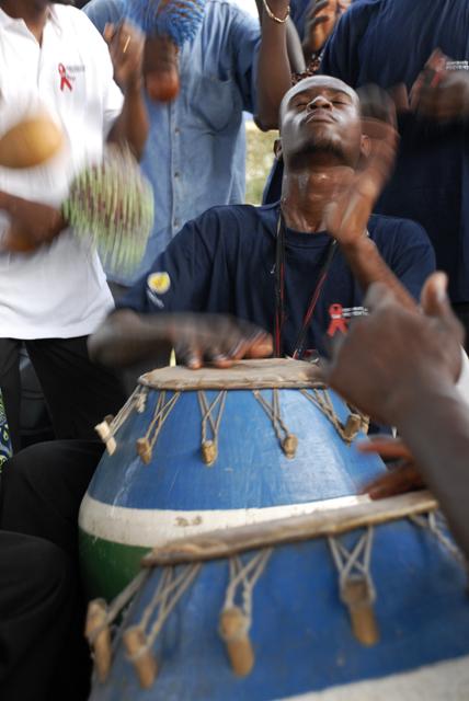 A drummer entertains participants of a health presentation in Lomé, Togo.