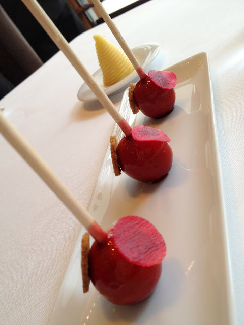 A trio of beet sticks, in a linear presentation.