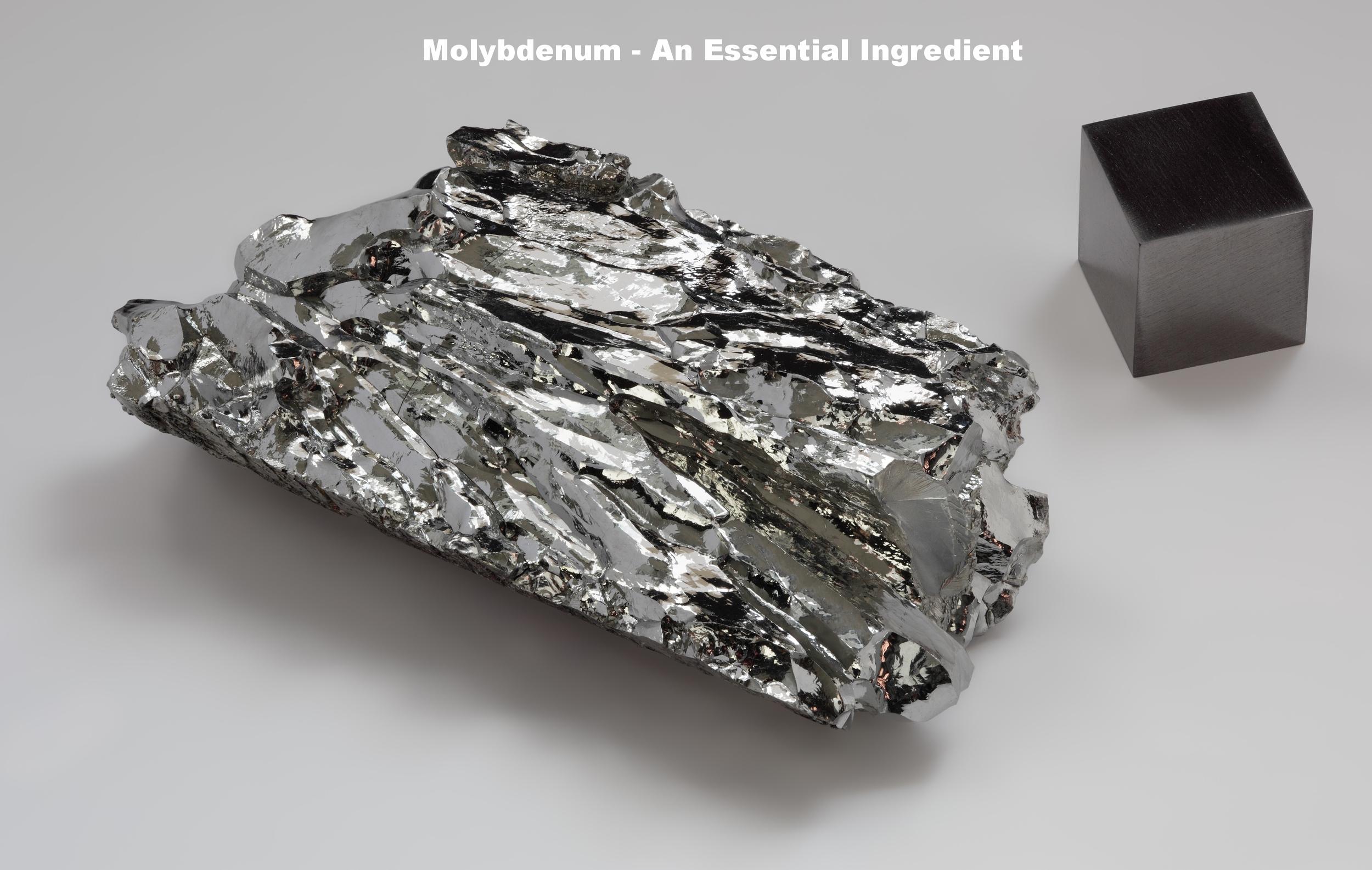 Molybdenum_crystaline_fragment_and_1cm3_cube.jpg
