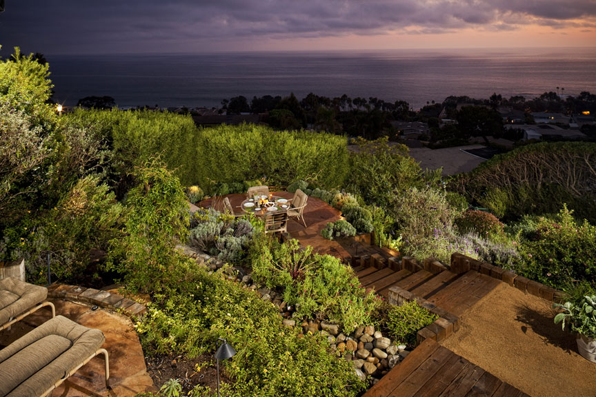 Outdoor living w/ vista viewing decks overlooking the Pacific Ocean.