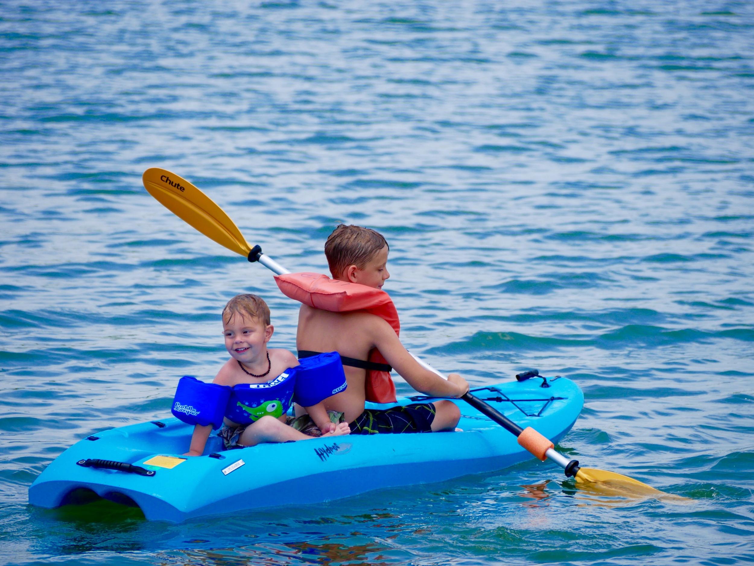 Boys learning to Kayak