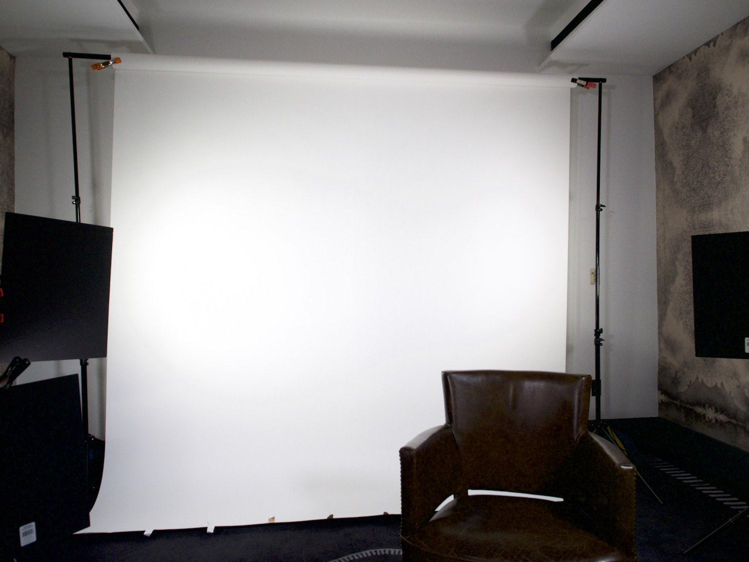 Behind the scenes interview setup with a white seamless backdrop