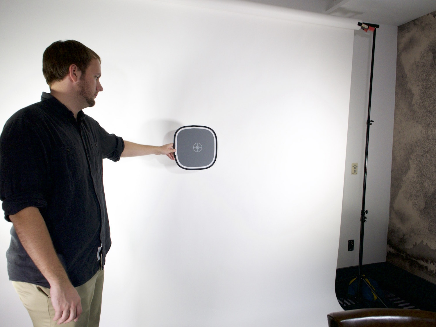 Behind the scenes interview getting exposure with grey card on a white seamless backdrop