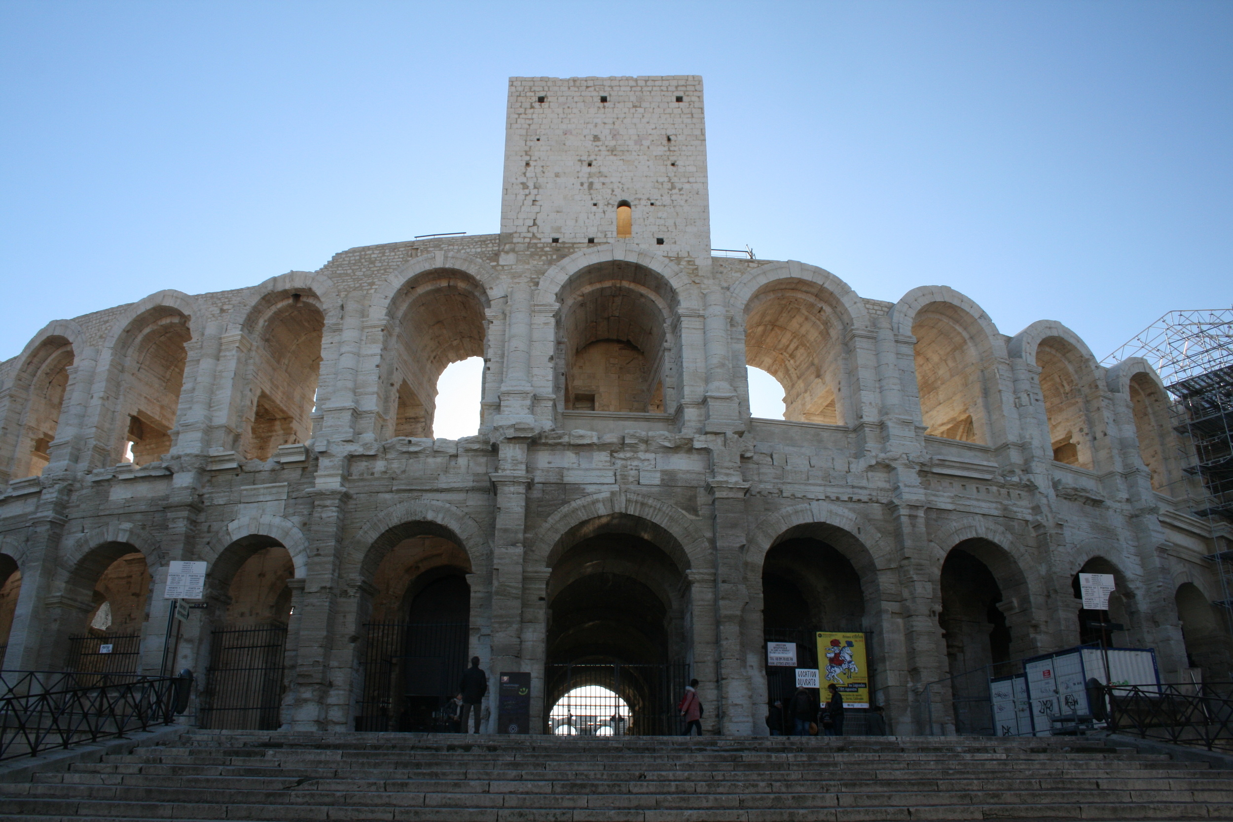 Rome's coliseum is to Arles' amphitheater as a football stadium is to a basketball court. But this one is better preserved than its more famous counterpart.