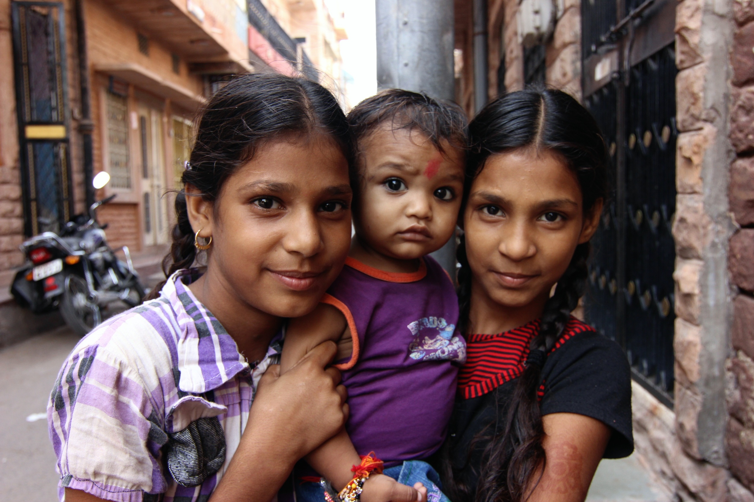 """Nisha, Banraj and Minu. They saw me walking back from the fort in Jodhpur and chased me down the street saying, """"Picture! Picture!"""" Then they asked for ink pens and rupees, in that order."""