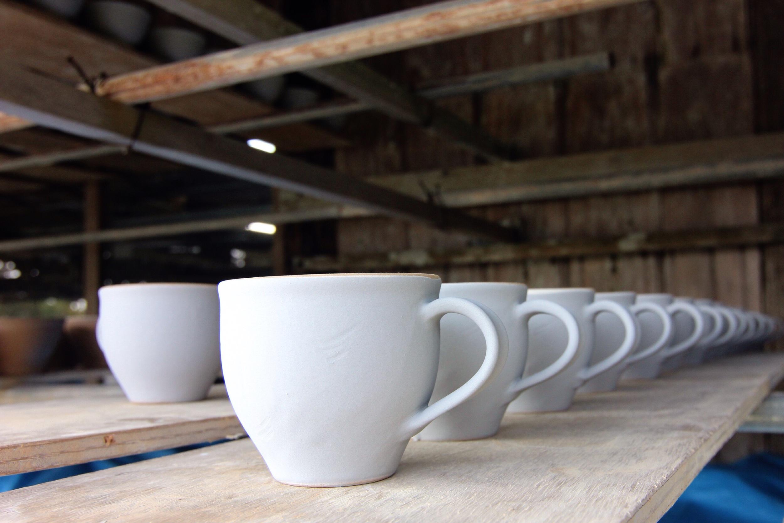 Mugs drying at a workshop in Yommitan.