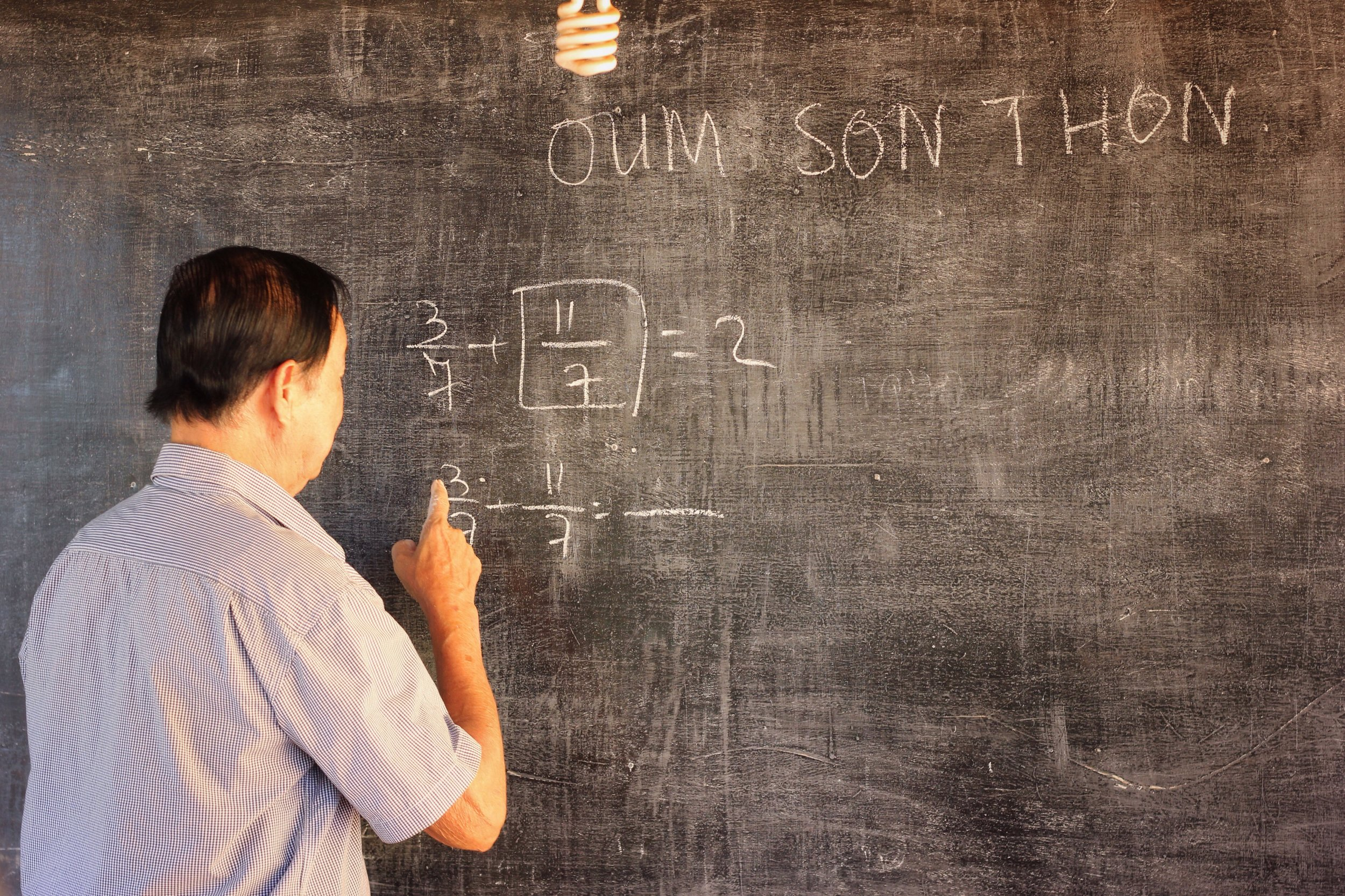 Oum Son Thon takes us through some math problems after giving us his history lesson.
