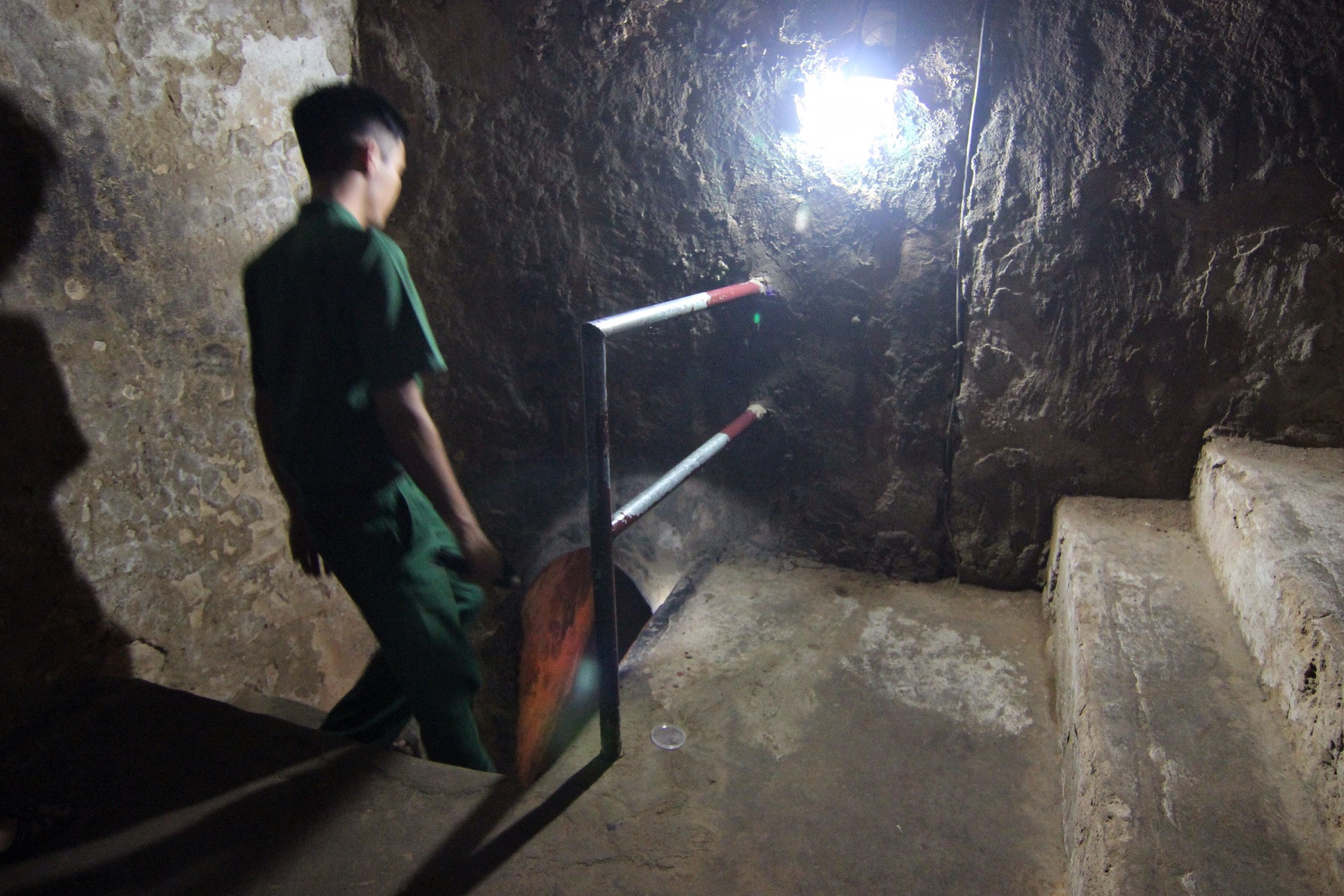 An employee leads us into a section of the original tunnel network.