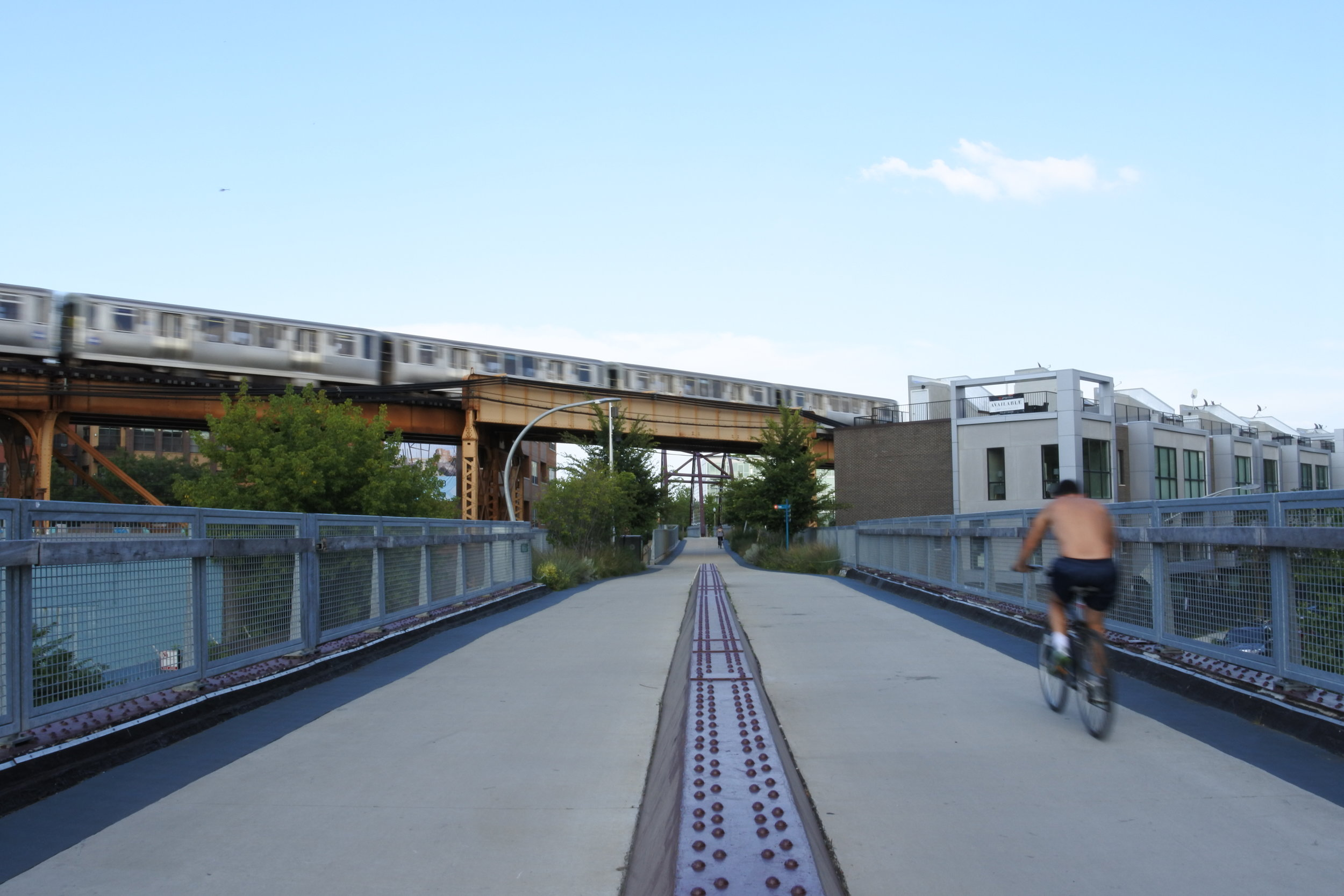 A biker on the 606, a former railroad line converted to public park.